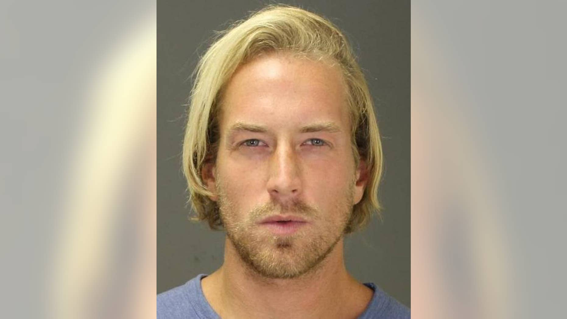FILE - This Sept. 2014 file photo provided by the Suffolk County District Attorney's office shows Thomas Gilbert Jr., after an arrest in the town of Southampton, N.Y., on a misdemeanor charge. Gilbert's hedge-fund founder father, Thomas Gilbert Sr., was found dead on Jan. 4, 2015, and his son was arrested and accused of murder. On Thursday, Feb. 5, 2015 Gilbert appeared in court in New York and pleaded not guilty to the charges. (AP Photo/Suffolk County District Attorney's office, File)
