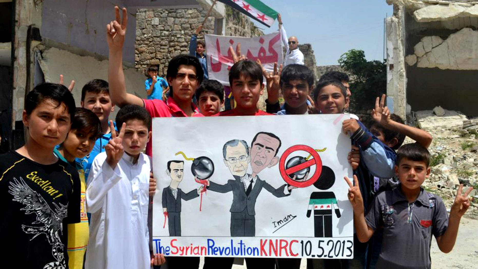"In this citizen journalism image provided by Edlib News Network, ENN, which has been authenticated based on its contents and other AP reporting, anti-Syrian regime protesters hold a poster depcting Syrian President Bashar Assad, left, Russian Foreign Minister Sergei Lavrov, center, and U.S. President Barack Obama, right during a demonstration, at Kafr Nabil town, in Idlib province, northern Syria, Friday May 10, 2013. Arabic on the banner background reads, ""Kafr Nabil."" (AP Photo/Edlib News Network ENN)"