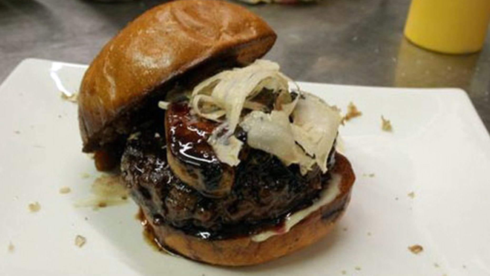 The MNO Burger is topped with truffles, foie gras and port.