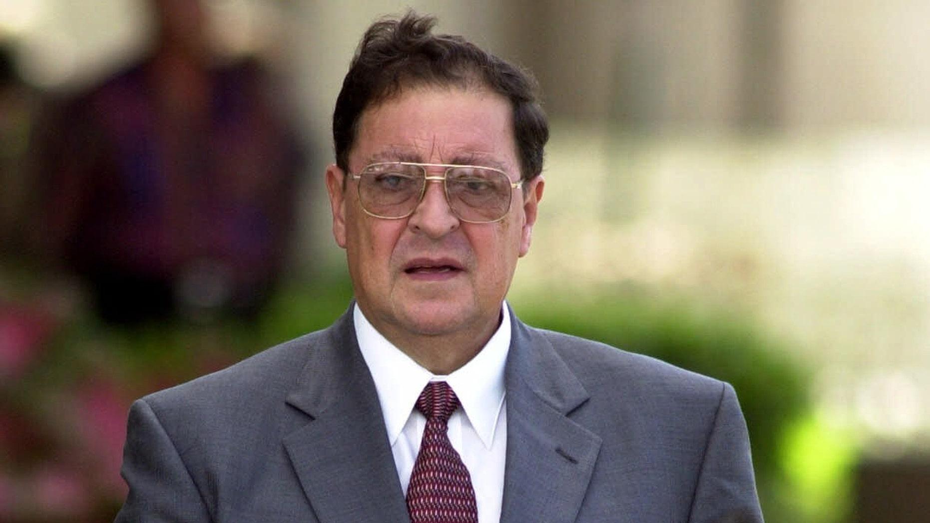 Former defense minister of El Salvador, Carlos Eugenio Vides Casanova, leaves federal court in Palm Beach, Fla.