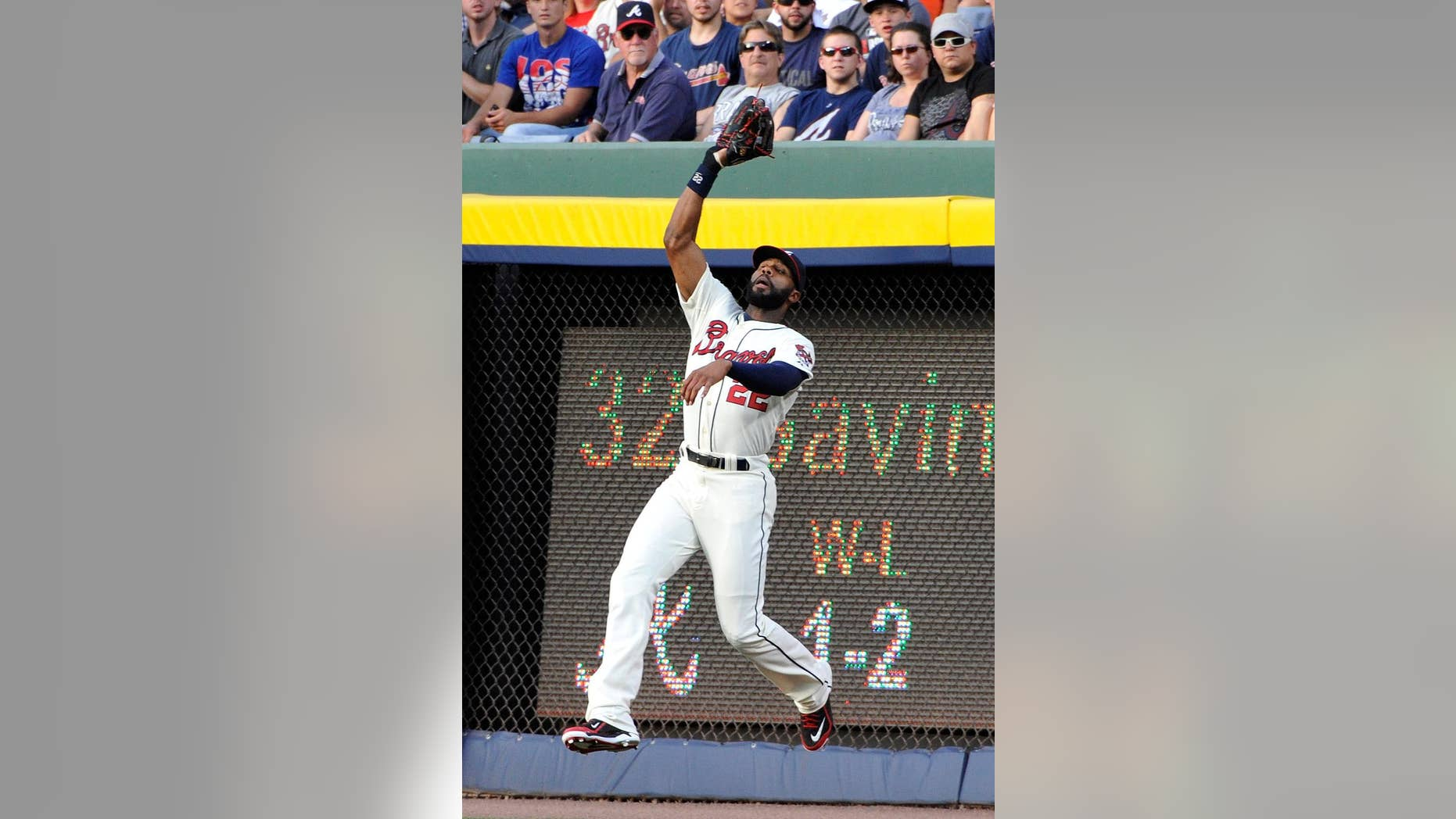 Atlanta Braves right fielder Jason Heyward fields a fly ball from Los Angeles Angels' David Freese for an out during the third inning of a baseball game on Saturday, June 14, 2014, in Atlanta. (AP Photo/David Tulis)