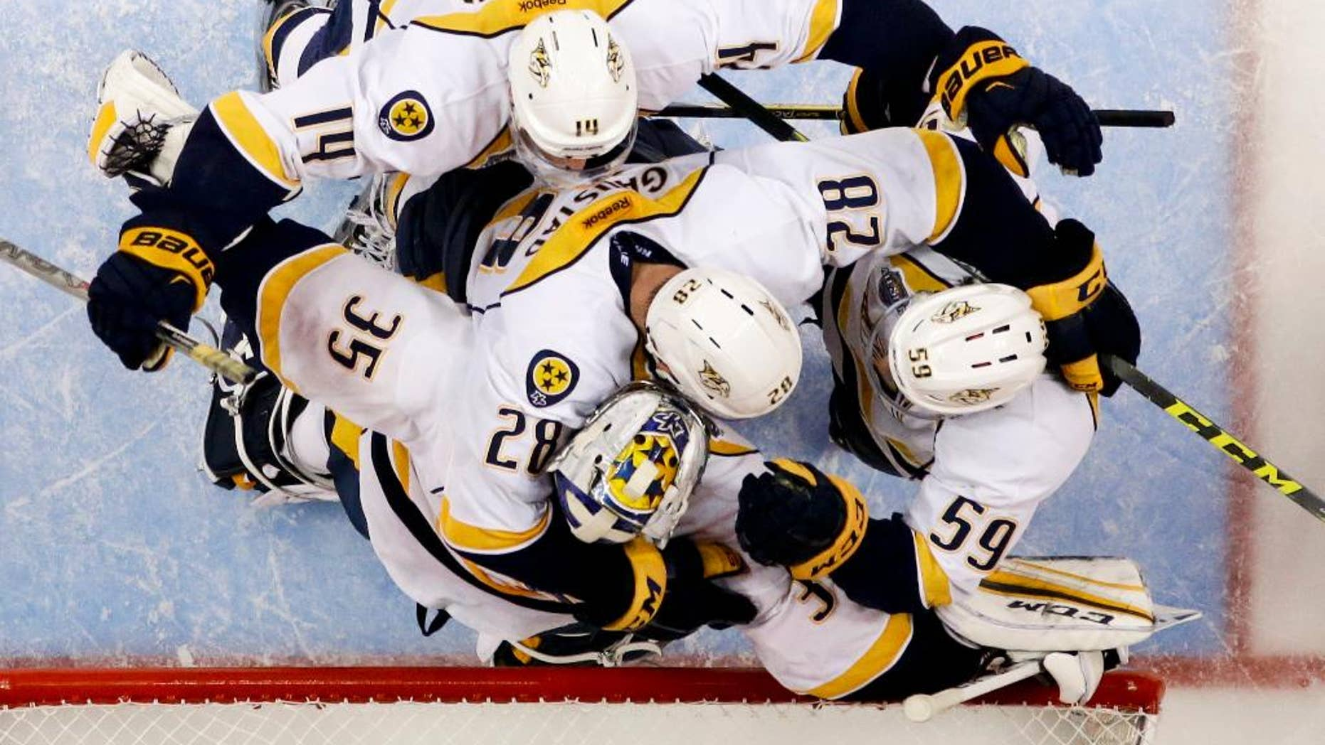 Nashville Predators celebrates a 2-1 win over the Anaheim Ducks during Game 7 in an NHL hockey Stanley Cup playoffs first-round series in Anaheim, Calif., Wednesday, April 27, 2016. (AP Photo/Chris Carlson)