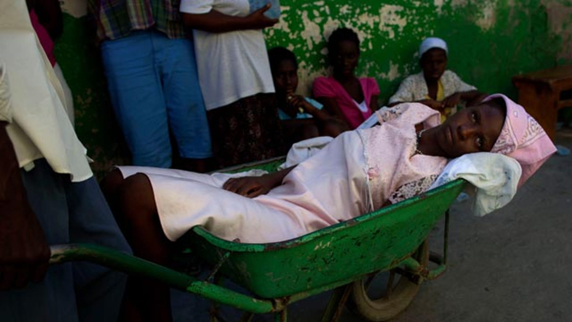Nov.  17: A woman suffering cholera symptoms is pushed in a wheelbarrow to St. Catherine hospital in Port-au-Prince, Haiti.  Haiti's cholera epidemic has killed at least 1,000 people and hospitalized thousands.