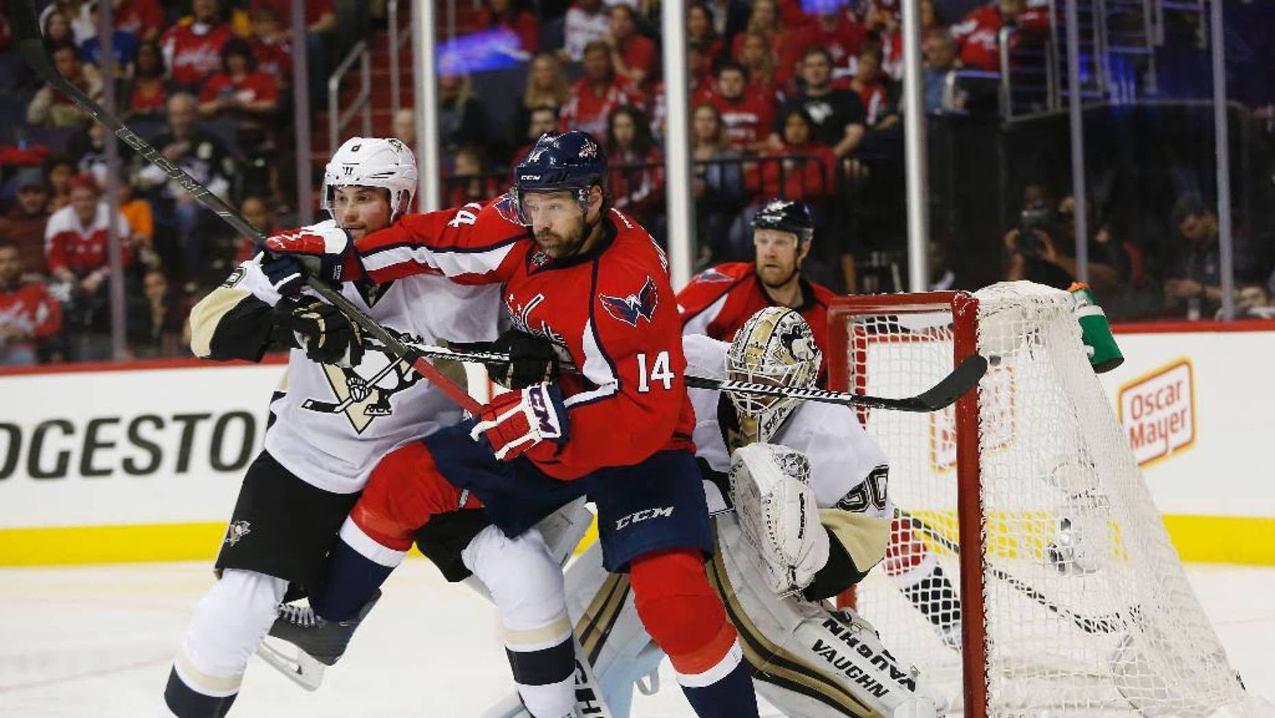 Washington Capitals right wing Justin Williams (14) and Pittsburgh Penguins defenseman Brian Dumoulin (8) shove each other as they work in front of Pittsburgh Penguins goalie Matt Murray (30) during the second period of Game 5 in an NHL hockey Stanley Cup Eastern Conference semifinals Saturday, May 7, 2016, in Washington. (AP Photo/Pablo Martinez Monsivais)