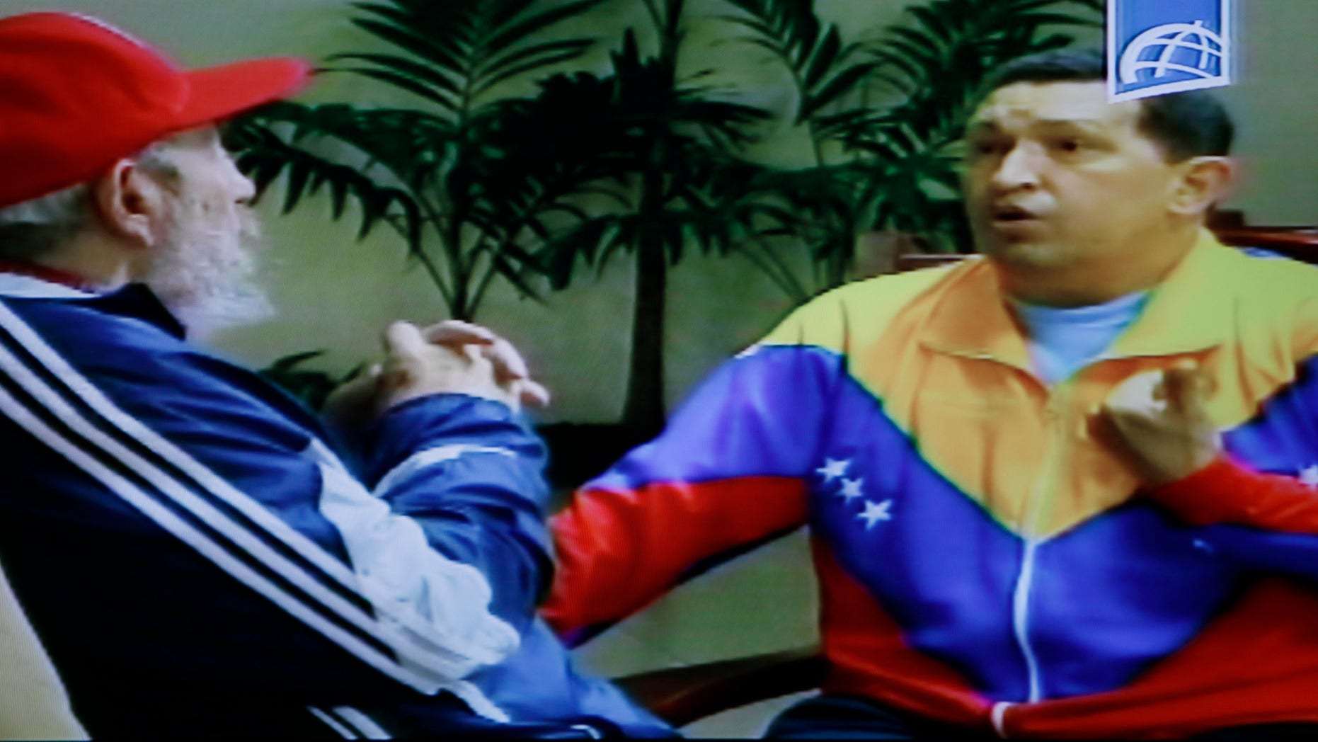 June 28: In this frame grab taken from video shown on Cuban state television, Cuba's Fidel Castro, left, speaks with Venezuela's President Hugo Chavez in an unknown location in Havana, Cuba.