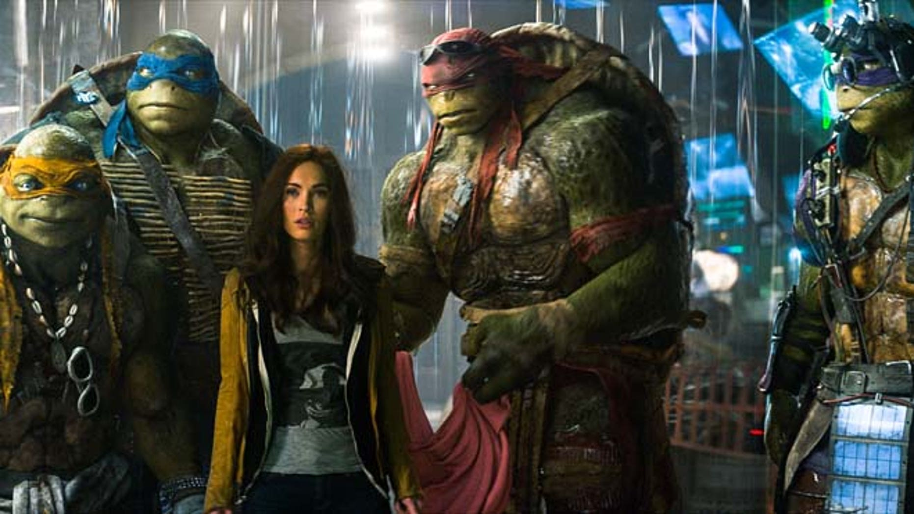 """This image shows, from left, Michelangelo, Leonardo, Megan Fox, as April O'Neil, Raphael, and Donatello in a scene from """"Teenage Mutant Ninja Turtles."""" (AP/Paramount Pictures, Industrial Light & Magic)"""