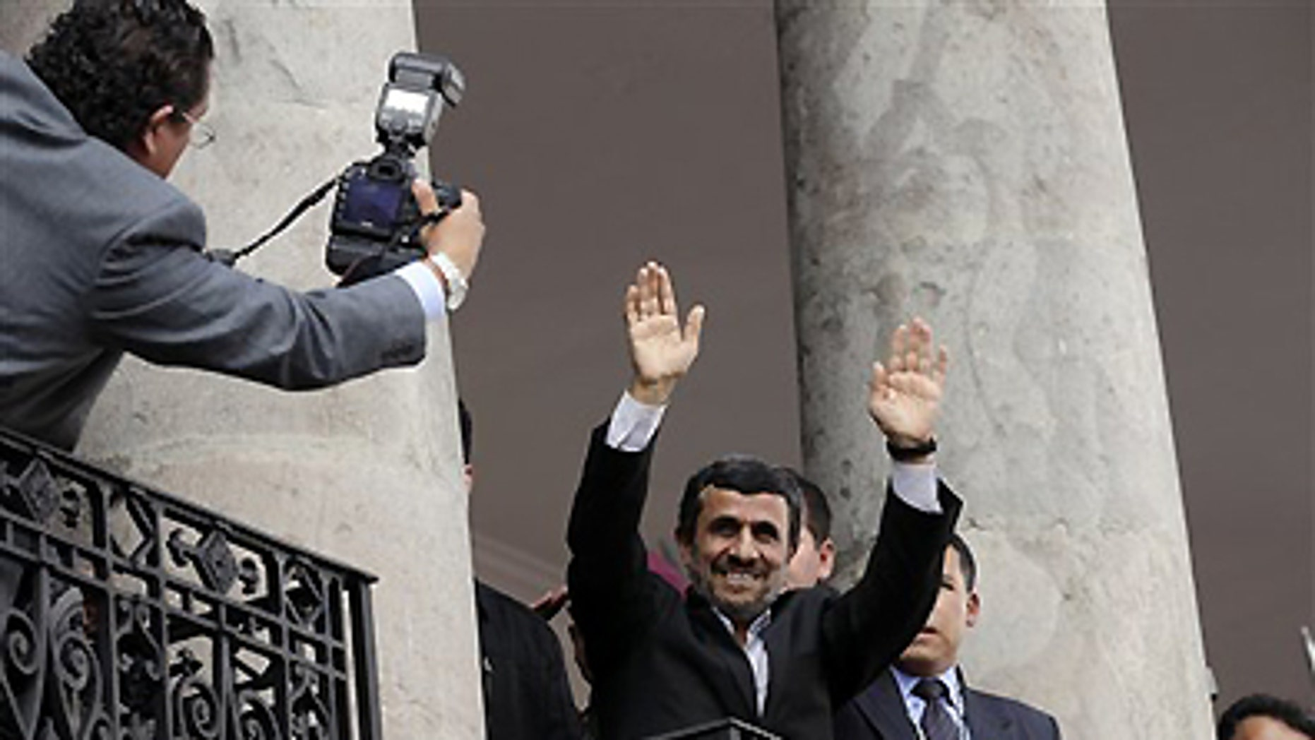 Jan. 12, 2012: Iran's President Mahmoud Ahmadinejad greets people from a balcony at the government palace in Quito, Ecuador.
