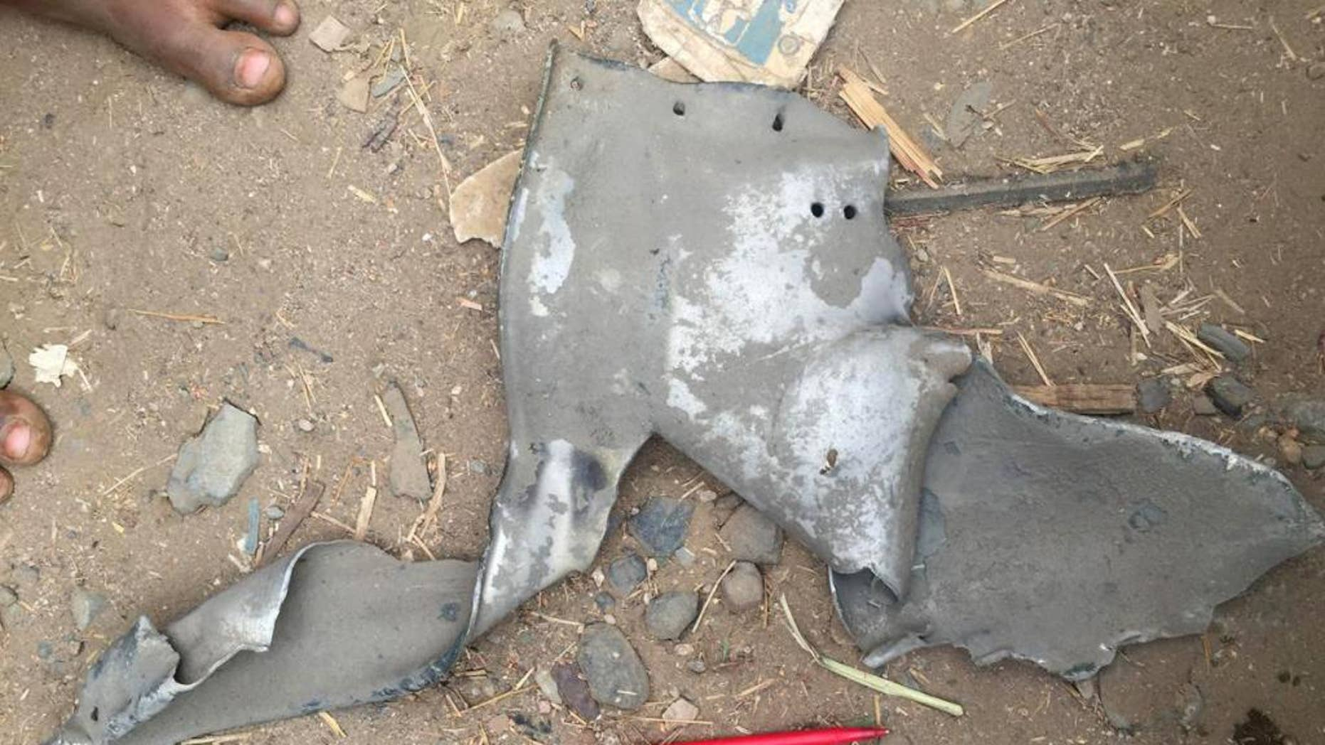 This image released by Human Rights Watch shows remnants of a bomb, found at the scene of a March 15, 2016 airstrike on Mastaba, Yemen. Human Rights Watch said Thursday, April 7, 2016 that their investigators found fragments of a GBU-31 satellite-guided bomb at the site of the market bombing in the northwestern town of Mastaba. The group said the bomb, as well as its guidance equipment, is made by the U.S. (Human Rights Watch via AP)