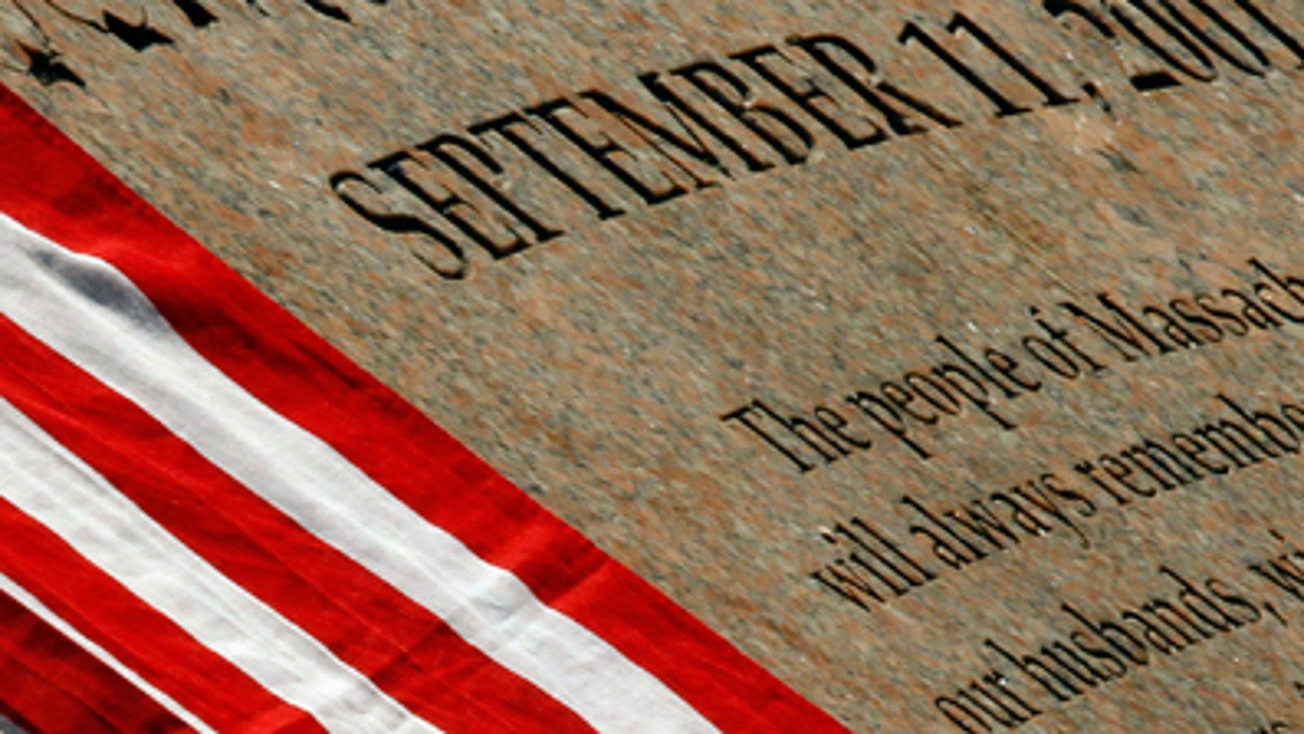 U.S. flag rests on the memorial to Massachusetts victims of the attacks of September 11, 2001 in Boston