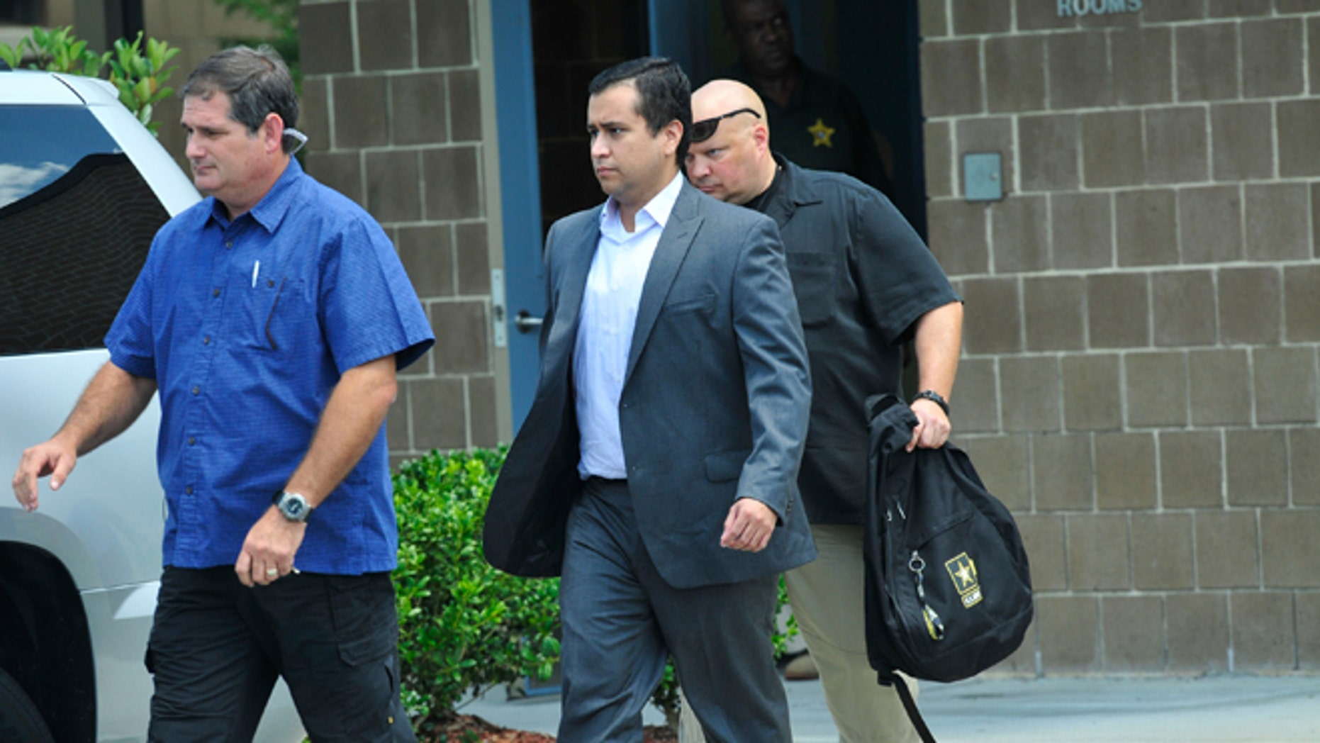 SANFORD, FL- JULY 6: George Zimmerman (C) leaves Seminole County Jail after posting a million dollar bond July 6, 2012 in Sanford, Florida. Zimmerman was charged with second degree murder in the shooting death of Trayvon Martin. (Photo by Roberto Gonzalez/Getty Images)