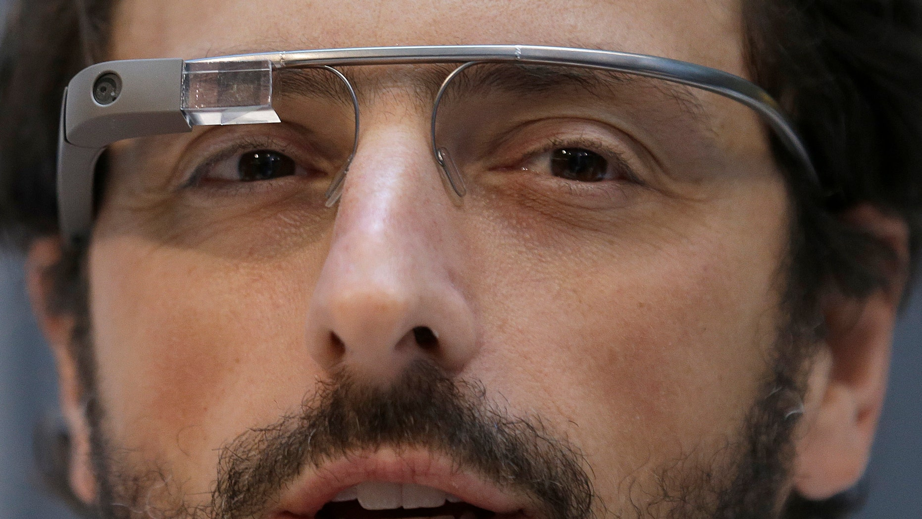 Google co-founder Sergey Brin wears Google Glass glasses at an announcement for the Breakthrough Prize in Life Sciences at Genentech Hall on UCSFs Mission Bay campus in San Francisco, Wednesday, Feb. 20, 2013. (AP Photo/Jeff Chiu)