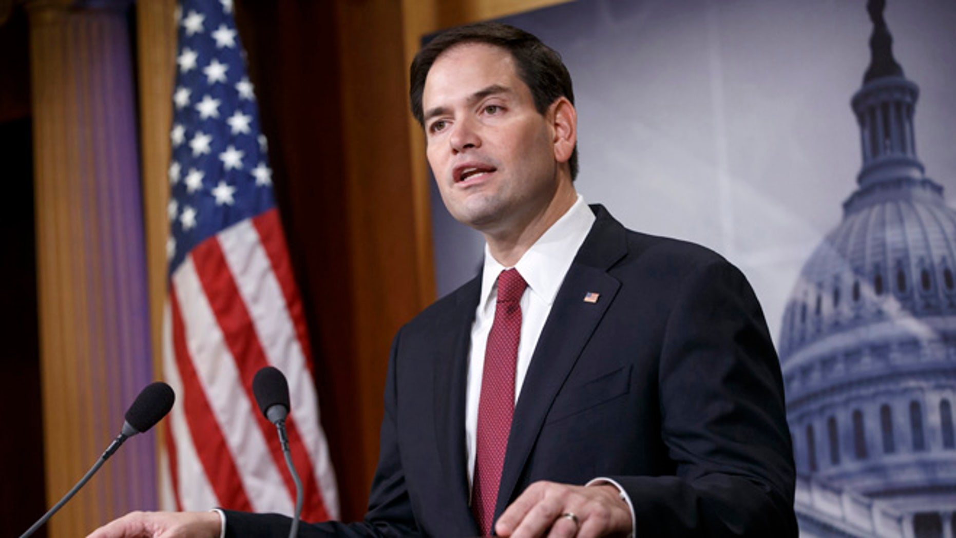 FILE - In this Dec. 17, 2014 file photo, Sen. Marco Rubio, R-Fla. speaks on Capitol Hill in Washington. Rubio seems to be moving toward a bid for the Republicans' presidential nomination, and late Sunday he joins Sens. Ted Cruz of Texas and Rand Paul of Kentucky for an audience with the conservative billionaire Koch brothers. (AP Photo/J. Scott Applewhite, File)