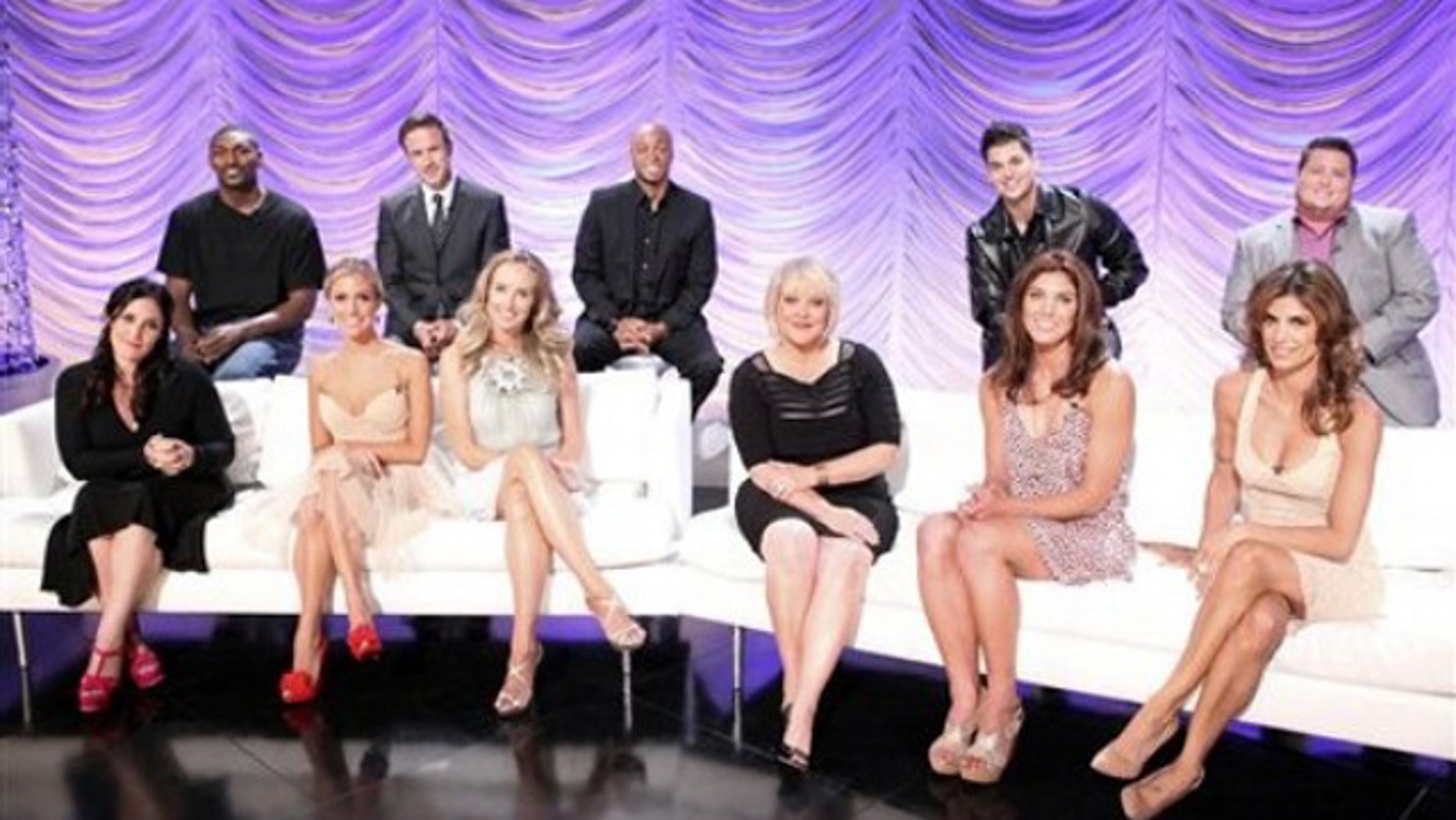 """In this image released by ABC, back row from left, NBA player Ron Artest, actor David Arquette, actor and Iraq War veteran J.R. Martinez, TV personality Rob Kardashian, activist Chaz Bono, seated from left, TV personalities Ricki Lake, Kristin Cavallari, singer Chynna Phillips, TV host Nancy Grace, Soccer player Hope Solo and Italian personality Elisabetta Canalis, the celebrity cast for the upcoming dance competition series, """"Dancing with the Stars,"""" pose for a portrait in Los Angeles. The series will premiere on Monday, Sept. 19, 2011 on ABC."""