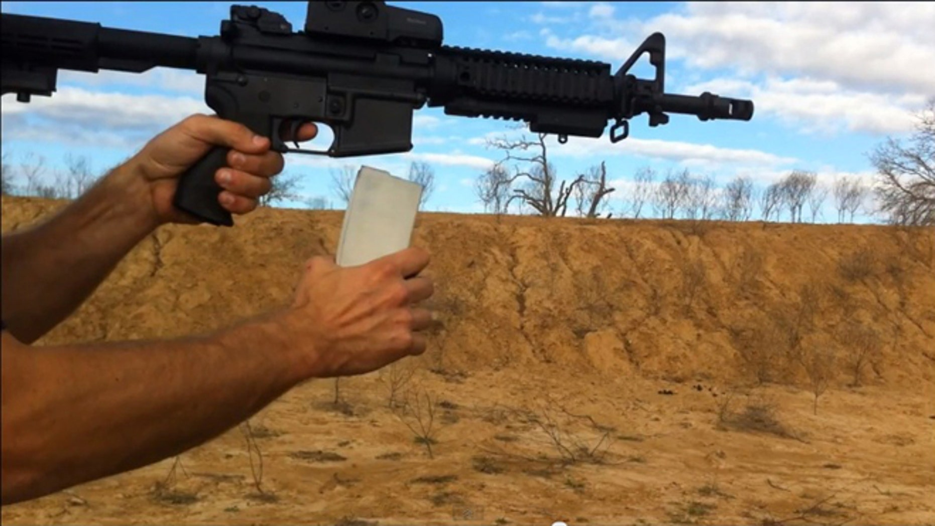 "Cody Wilson of Defense Distributed testing out the ""Cuomo Clip"" -- a 3D printed gun clip."