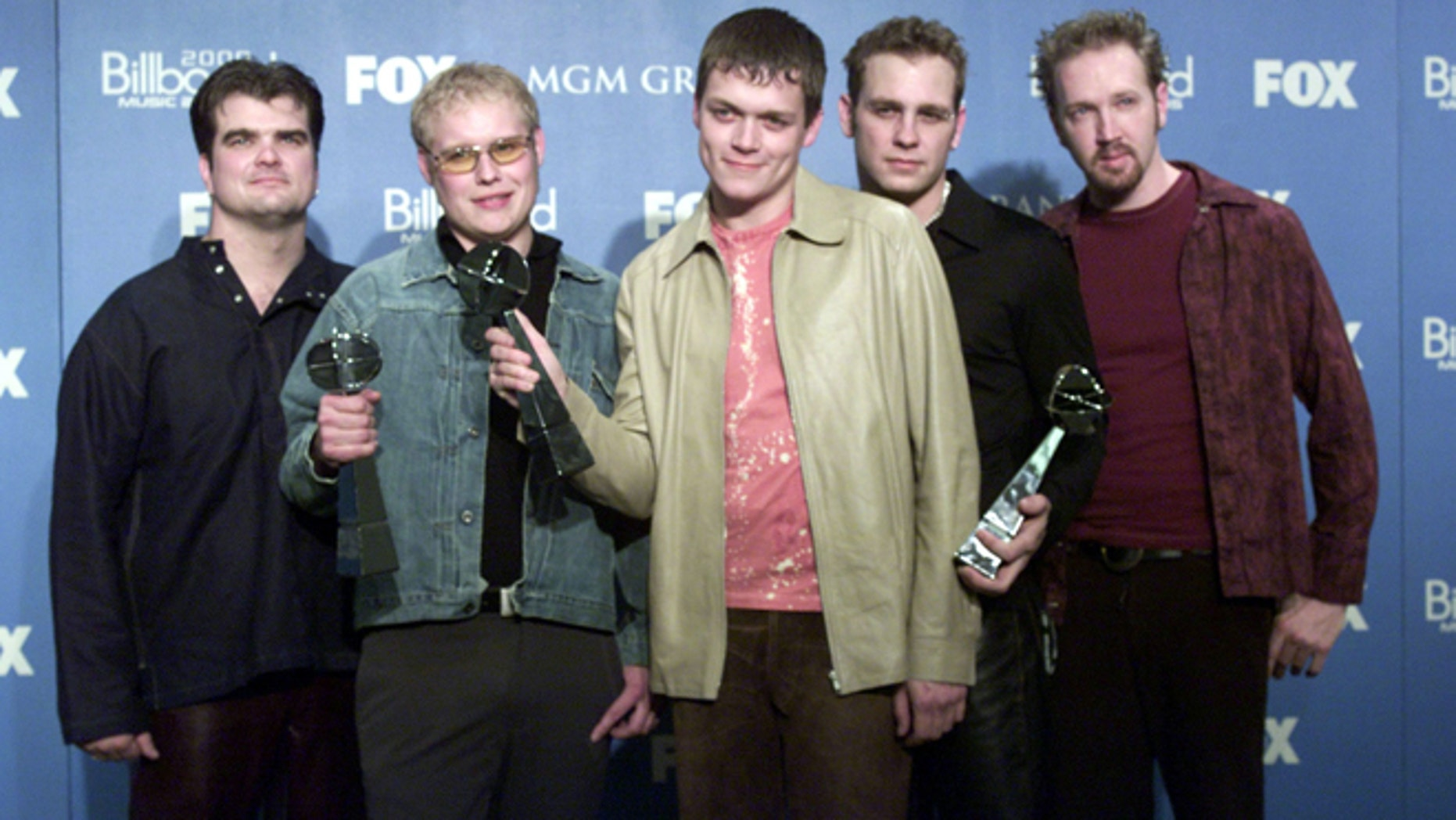 """Dec. 5, 2000: Members of the pop music group """" 3 Doors Down """" (L-R) Chris Henderson, Matt Roberts, Brad Arnold, Todd Harrell and Rich Liles pose for photographers with their award for Rock Track of the year for """" Kryptonite"""" at the 2000 Billboard Music Awards at the MGM Grand in Las Vegas."""