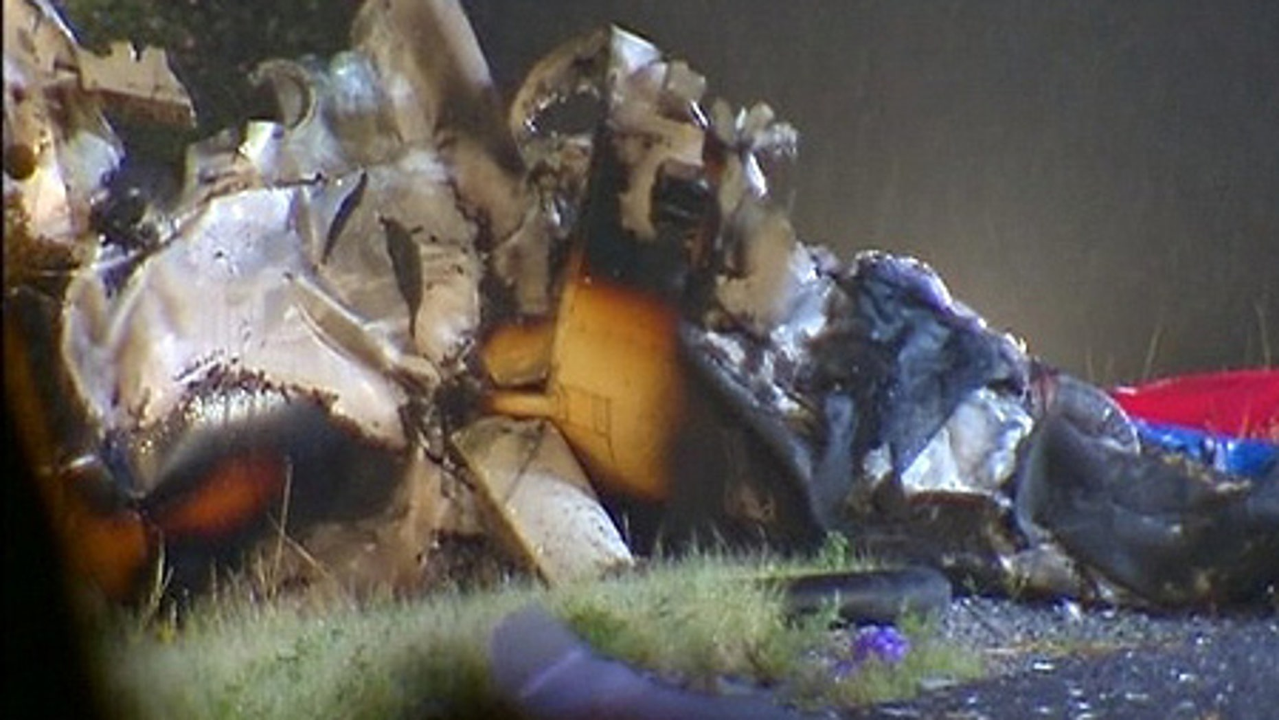 July 24: Wreckage of a Robinson R-44 helicopter is removed from the eastbound lanes of Interstate 70.