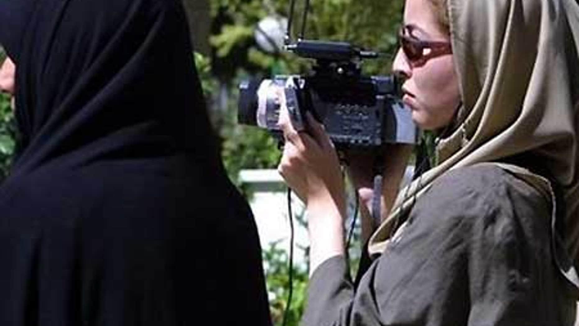 File: U.S. journalist Roxana Saberi filming in Tehran.