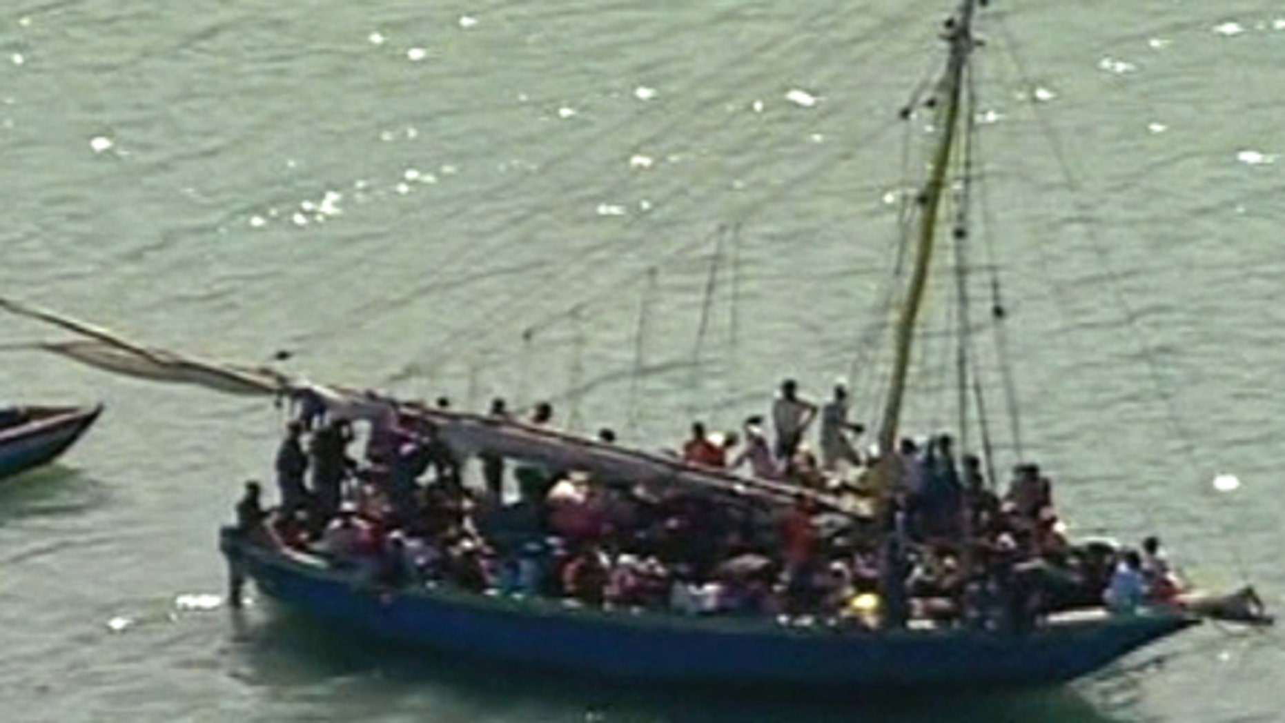 Jan. 15: Haitians attempt to leave Carrefour, south of Port-au-Prince, by boat in this still from APTN video.