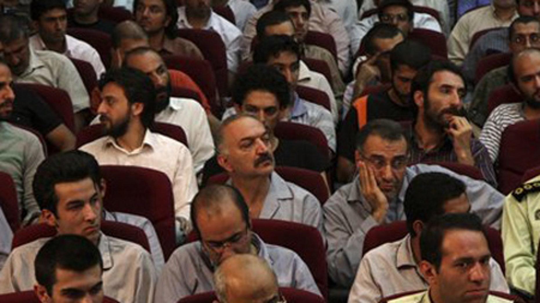 Aug. 1: Defendants sit in a court room in Tehran, Iran.