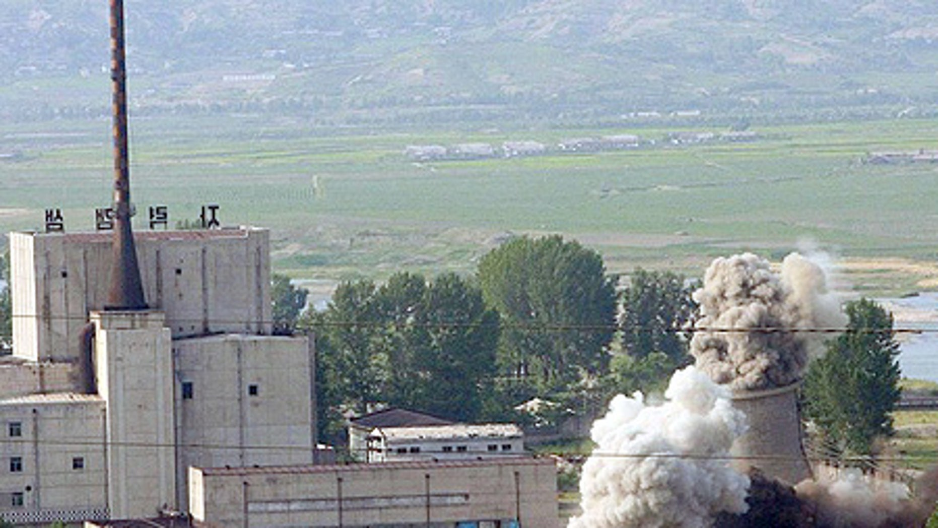 File: The cooling tower of North Korea's Yongbyon nuclear complex, a plutonium-producing reactor, was demolished on June 27, 2008.