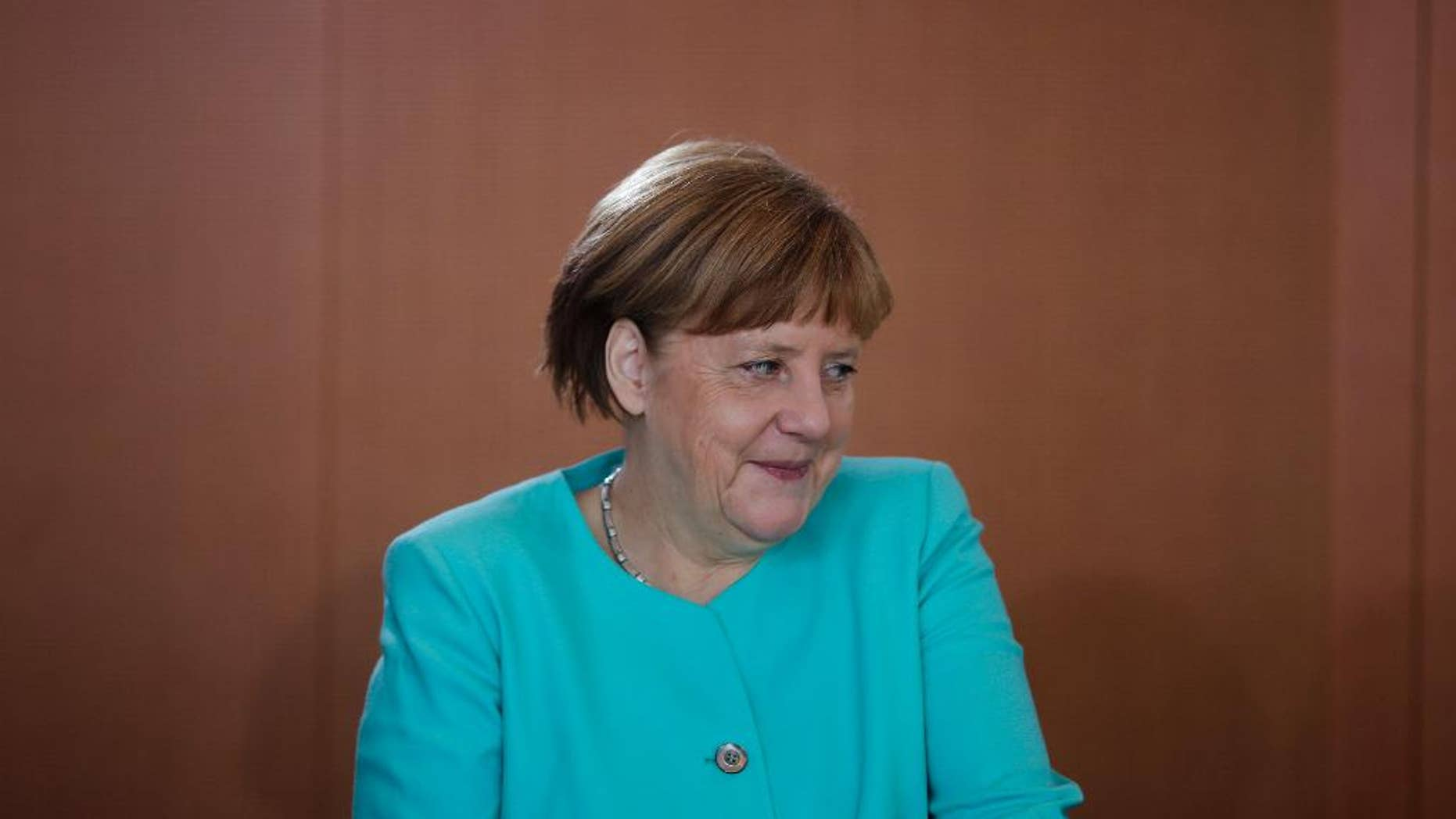 German Chancellor Angela Merkel arrives for the cabinet meeting of the German government at the chancellery in Berlin, Wednesday, June 8, 2016. (AP Photo/Markus Schreiber)