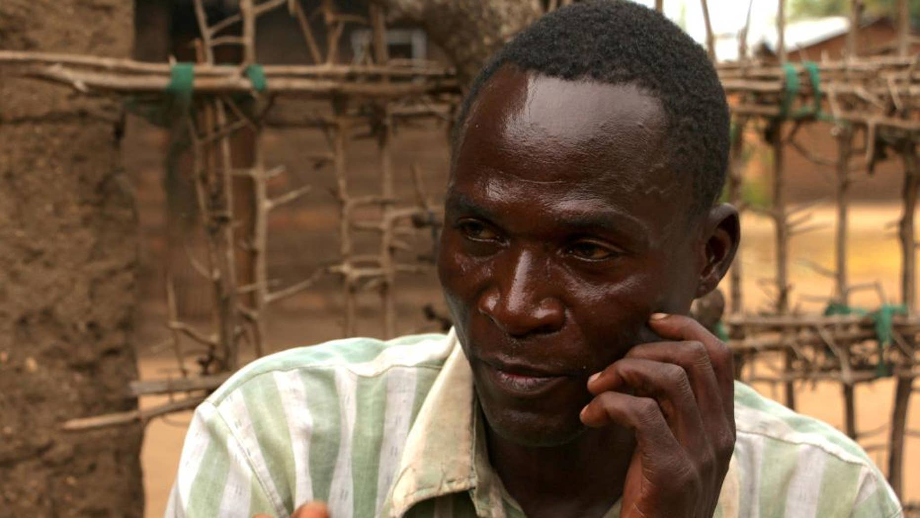 In this photo taken Thursday, June 30, 2016, Eric Aniva is photographed near Blantyre, Malawi. Malawian police on Tuesday July 26, 2016 have arrested Aniva who said he was hired by families to have sex with more than 100 young women, including children, in what was described as ritual cleansing. The country's president ordered the man's arrest after he told international media about his actions and said he is HIV-positive. (AP Photo/Eldson Chagara)