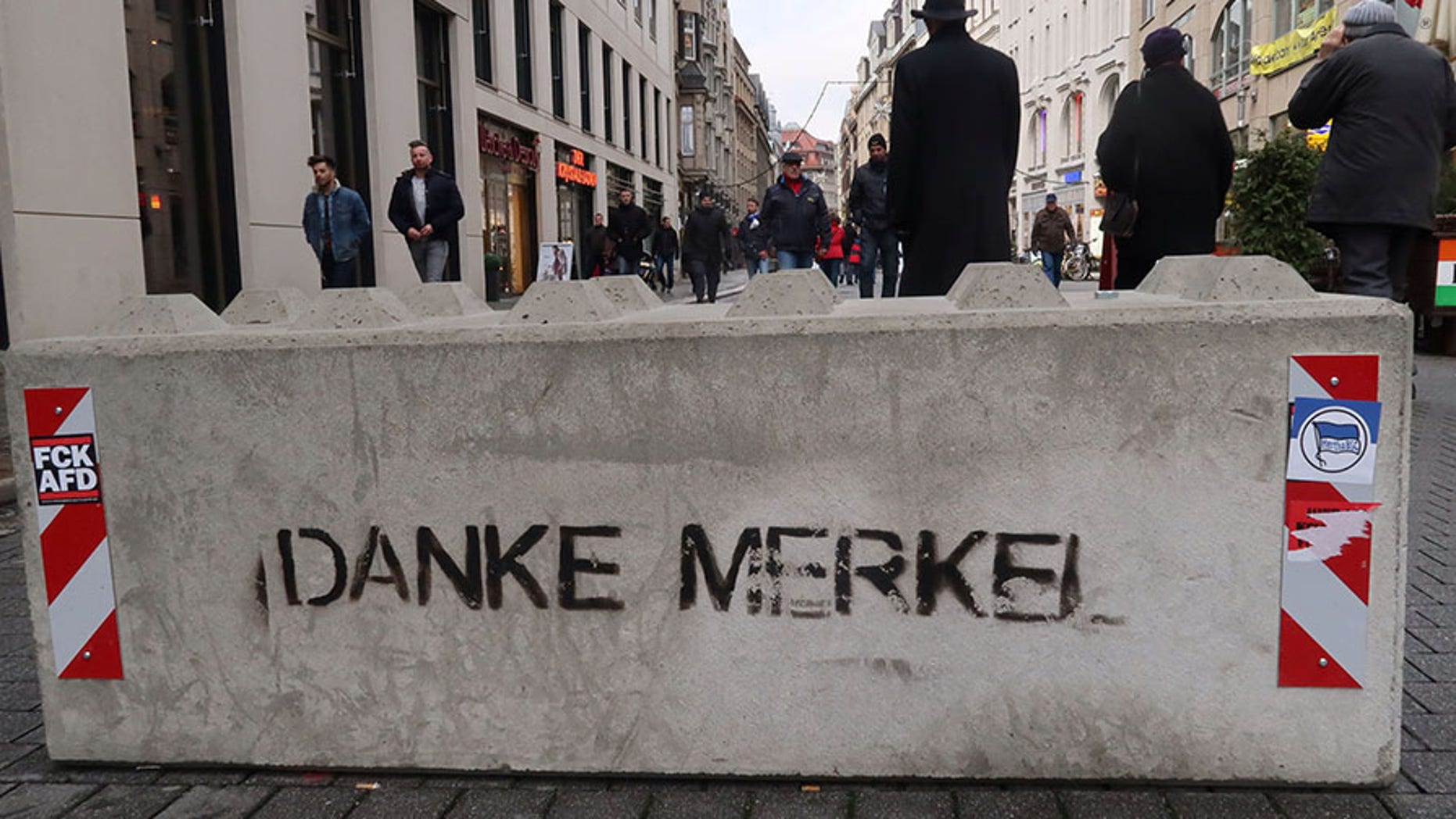 """Dec. 17, 2017: Graffiti on a concrete barrier reads """"Thanks Merkel"""" in German at a Christmas market in the eastern German city of Leipzig, Germany."""