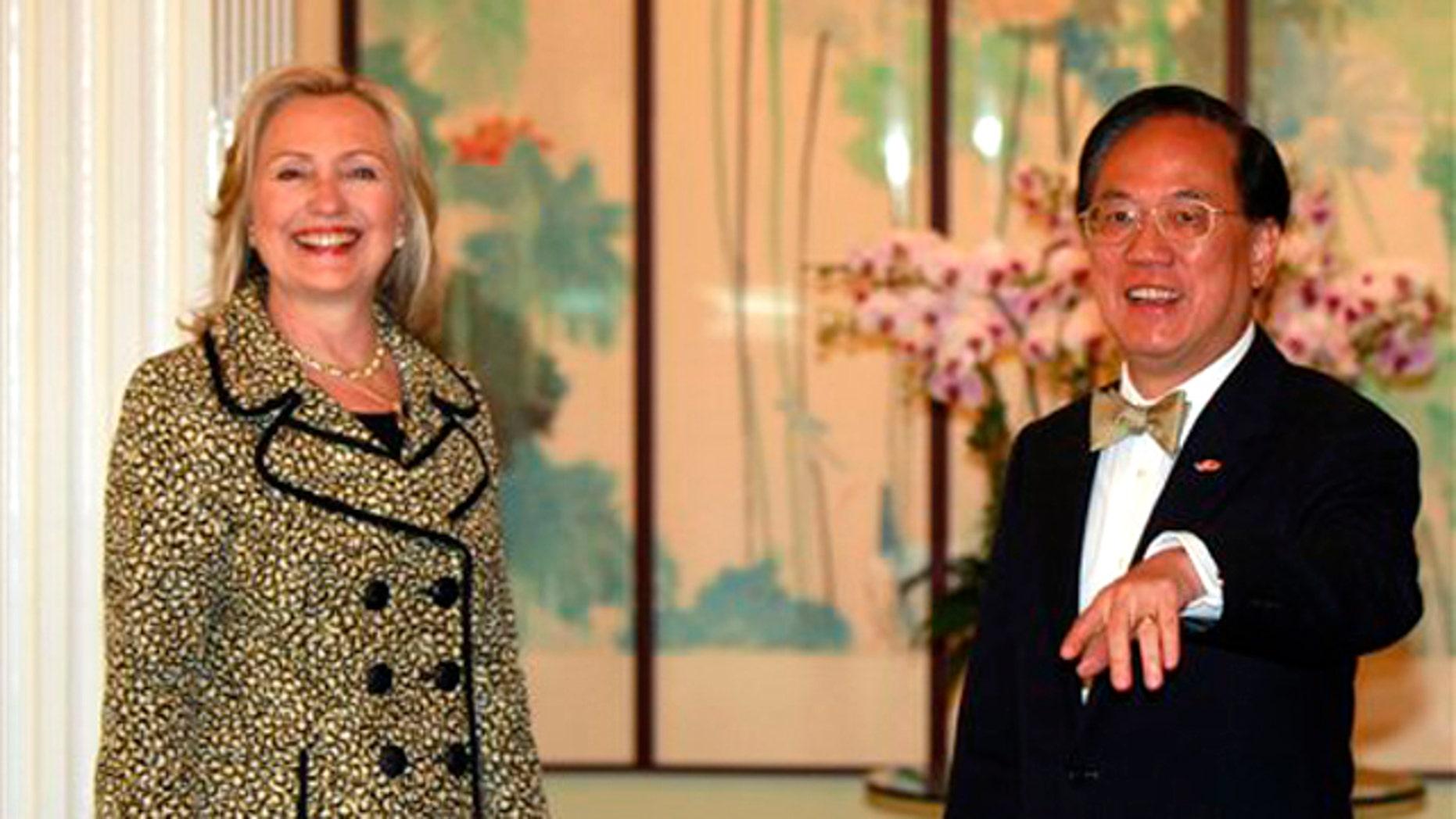 Hong Kong's Chief Executive Donald Tsang, right, greets U.S. Secretary of State Hillary Rodham Clinton at Government House in Hong Kong, China, Monday, July 25, 2011.