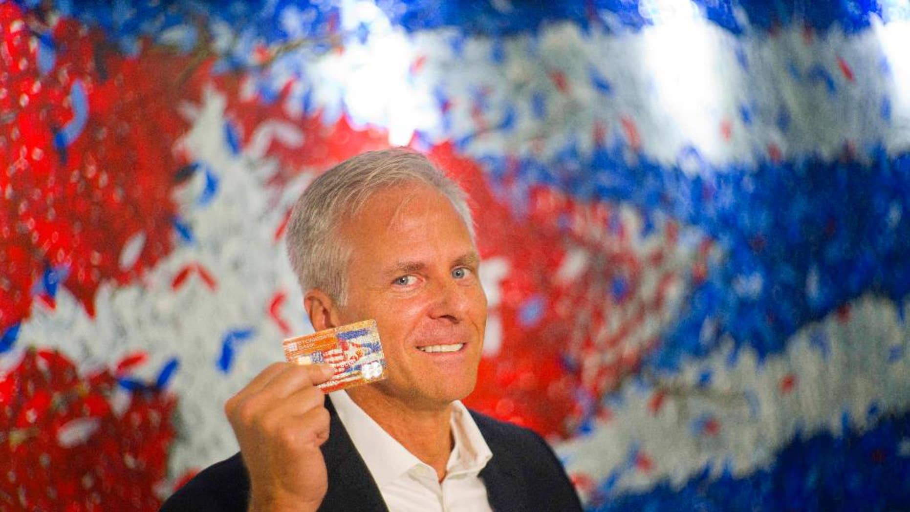 In this June 8, 2016 photo, Stonegate Bank President David Seleski poses with a credit card during an interview in Havana, Cuba.  Stonegate, a small Florida bank, will issue the first U.S. credit card designed to work in Cuba on Wednesday, June 15, making it easier for American companies to do business on an island largely cut off from the U.S. financial system. (AP Photo/Ramon Espinosa)
