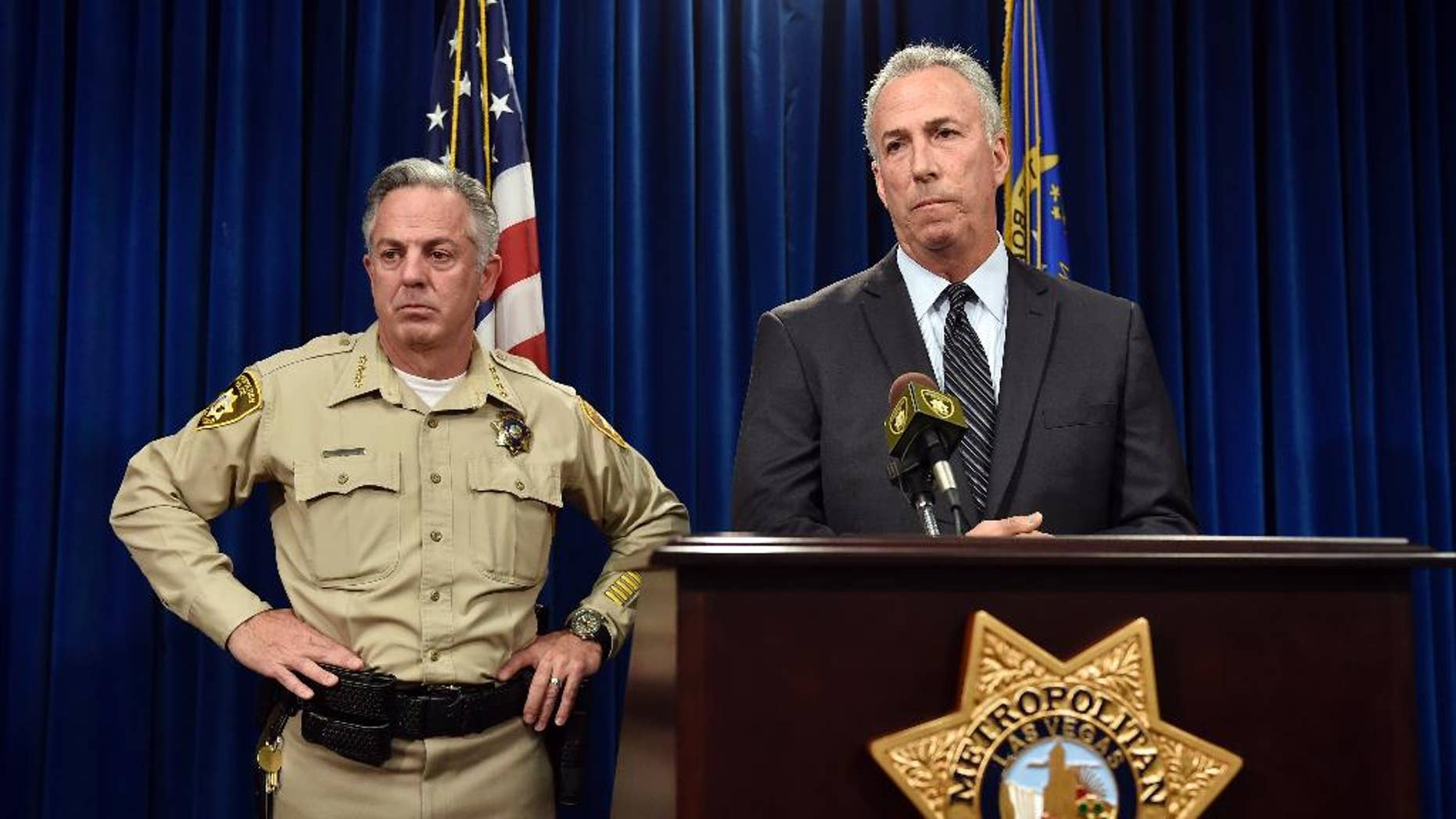 Clark County Sheriff Joe Lombardo, left, and Clark County District Attorney Steve Wolfson attend at a news conference, Monday, Dec. 21, 2015, in Las Vegas. The two officials spoke about the car driven by suspect Lakeisha N. Holloway, of Oregon, who police said smashed into crowds of pedestrians on the Las Vegas Strip on Sunday night, killing one person and injuring dozens. (AP Photo/David Becker)