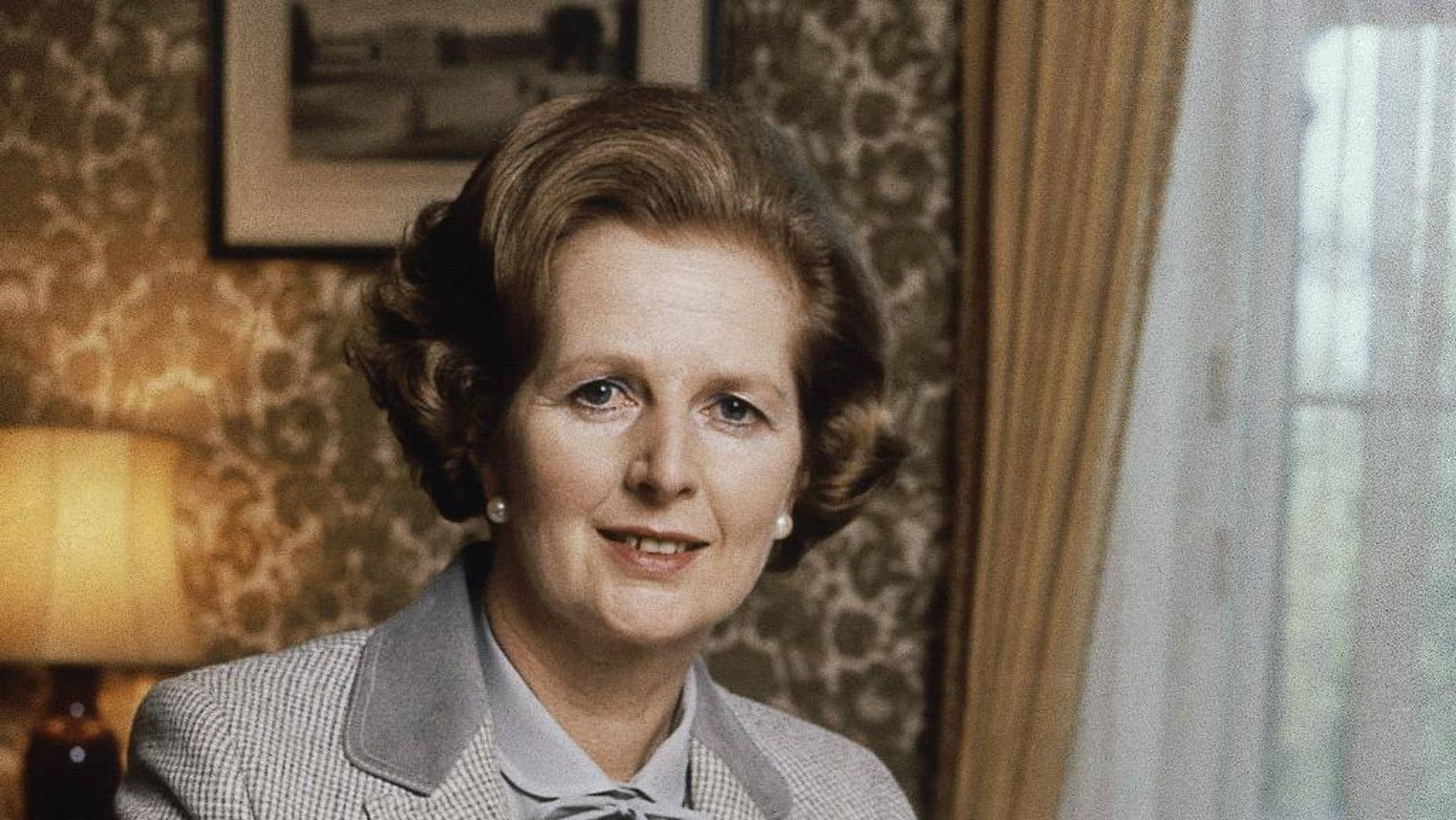 FILE - In this 1980 file photo, British Prime Minister Margaret Thatcher poses for a photograph in London. Newly released official papers show that former Prime Minister Margaret Thatcher's government considered rebuilding Britain's chemical weapons arsenal in the face of a Soviet threat in the early 1980s. (AP Photo/Gerald Penny, File)