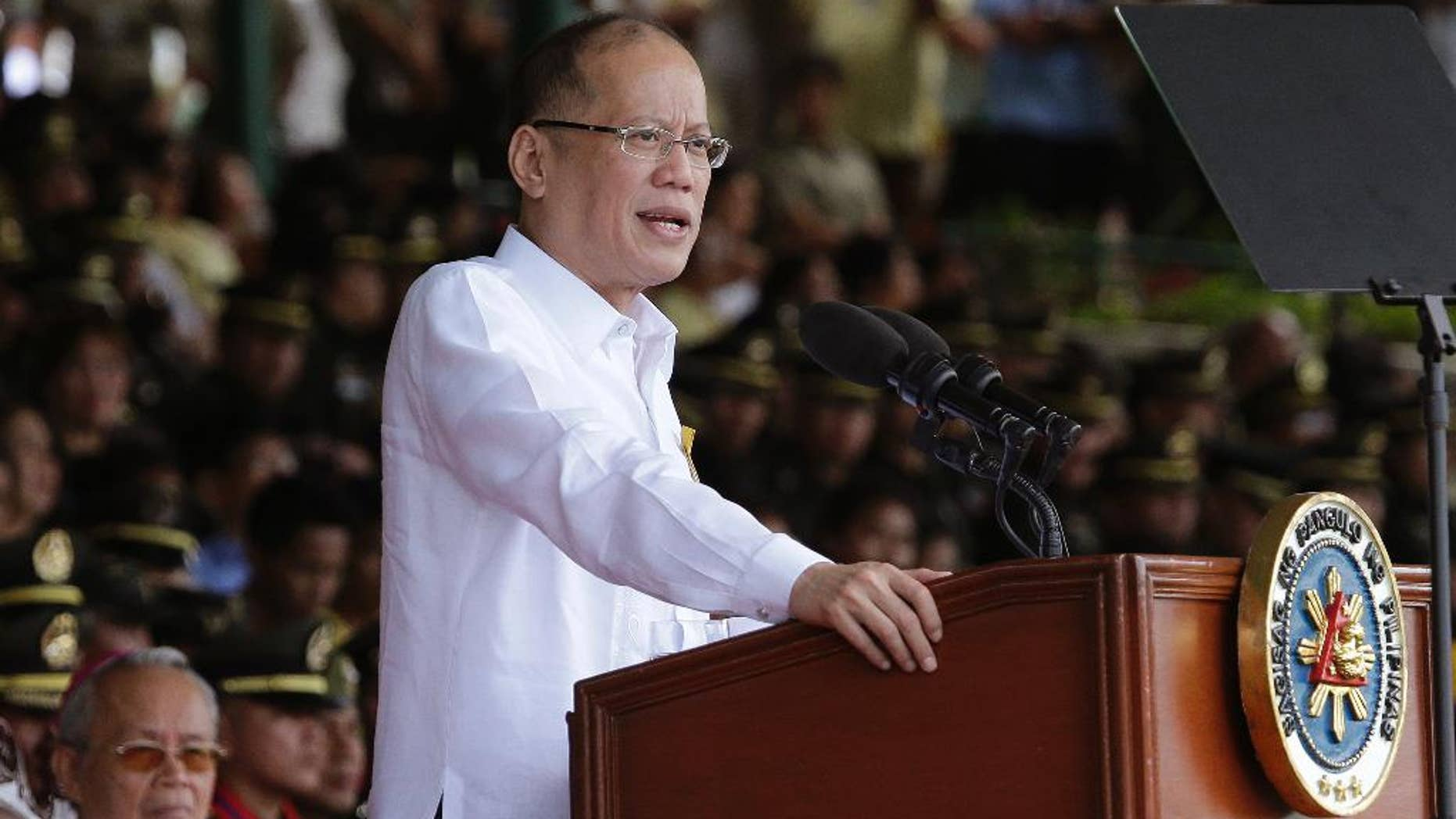 """FILE - In this file photo from March 22, 2016, Philippine President Benigno Aquino III delivers a speech south of Manila, Philippines, on Tuesday, March 22, 2016. Aquino has called this week's election a referendum on his """"straight path"""" style of reformist governance, but his candidate Sen. Ferdinand """"Bongbong"""" Marcos Jr. has lost by millions of votes to a shoot-from-the-lip mayor. (AP Photo/Aaron Favila, File)"""