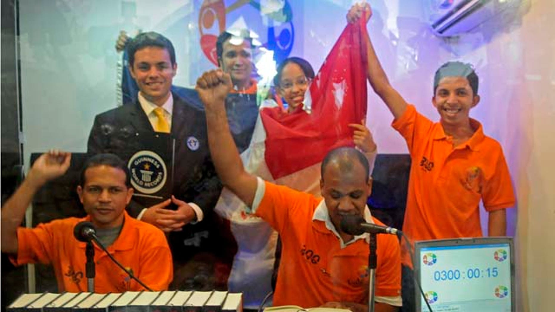 Michael Janela, second from left, judge of the Guinness World Records, poses with Dominican students, from left, Carlos Jose Reyes, Cristian Rodriguez, Martha Esther Madera, Randolfo Jimenez and Jose Manuel Bueno.