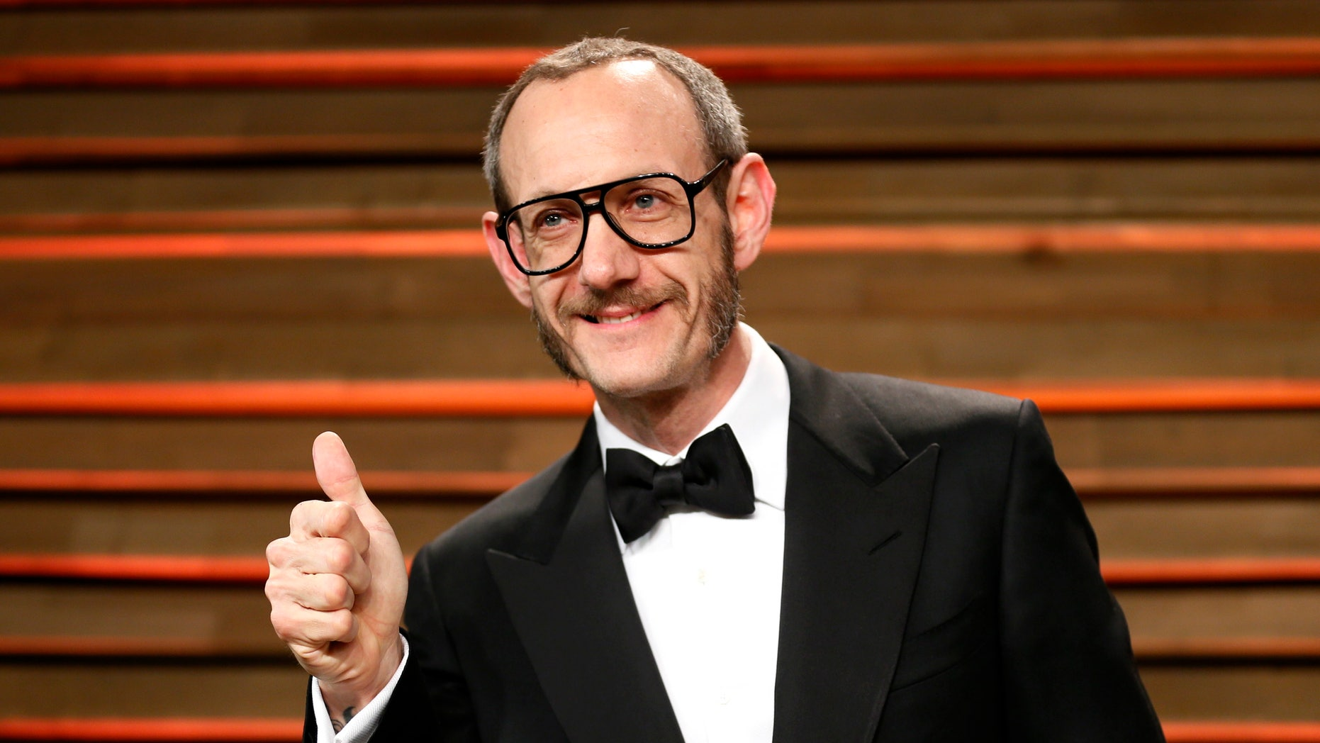 Photographer Terry Richardson arrives at the 2014 Vanity Fair Oscars Party in West Hollywood, California March 2, 2014.