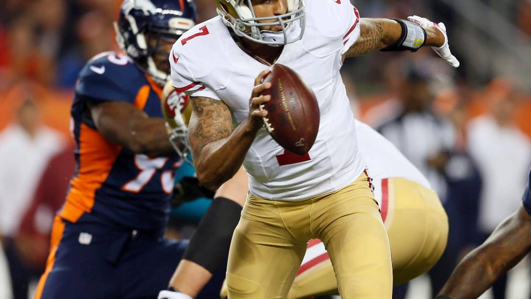 San Francisco 49ers quarterback Colin Kaepernick (7) is hurried against the Denver Broncos during the first half of an NFL football game, Sunday, Oct. 19, 2014, in Denver. (AP Photo/Joe Mahoney)