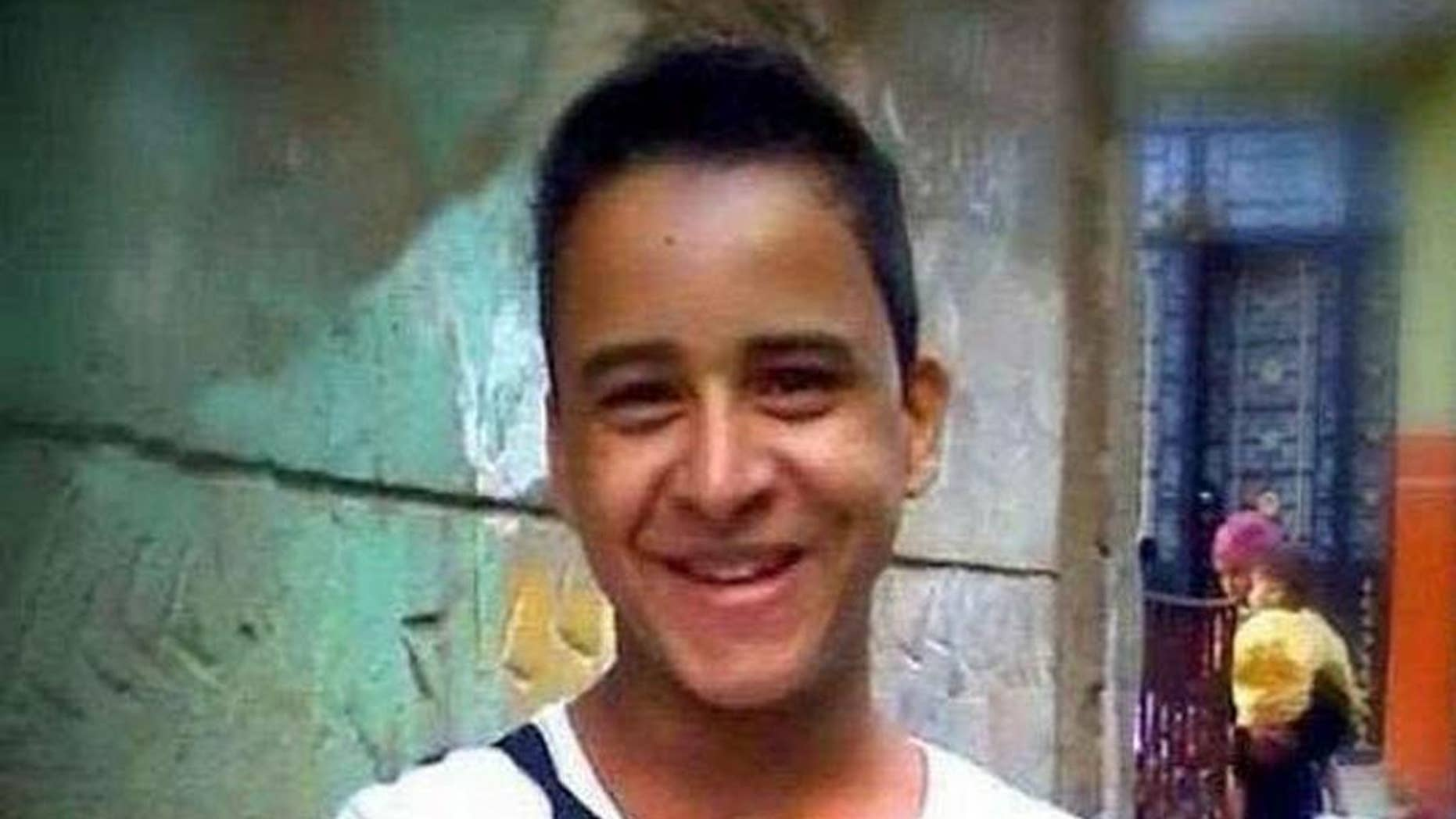 """This undated photo provided by the family of Mahmoud Mohammed Ahmed, shows Mahmoud Mohammed Ahmed in Cairo, Egypt prior to his arrest in Jan 2014 while wearing a T-shirt that bore the slogan """"A nation without torture."""" An Egyptian court on Thursday, March 24, 2016 ordered the release of Ahmed, who was accused by police of taking part in unauthorized demonstrations, possession of explosives and paying money to others to take part in street protests, his brother and lawyer told The Associated Press. He was never formally charged during his two years in detention. (Family of Mahmoud Mohammed Ahmed via AP)"""