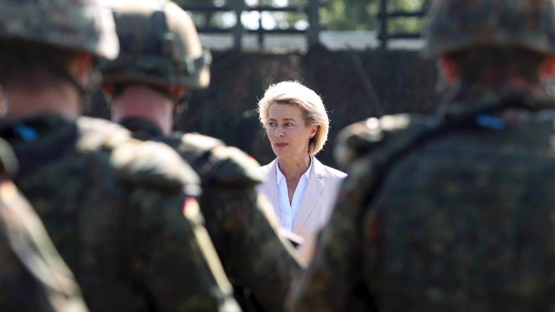 FILE - In this Aug. 16, 2016 file photo German Defence Minister Ursula von der Leyen speaks to soldiers from the German army in Weissenfels, Germany. Federal prosecutor's spokeswoman Frauke Koehler said that 27-year-old Maximilian T. was arrested in the southwestern city of Kehl on Tuesday, May 9, 2017 on charges of preparing an act of violence. (Sebastian Willnow/dpa via AP, file)
