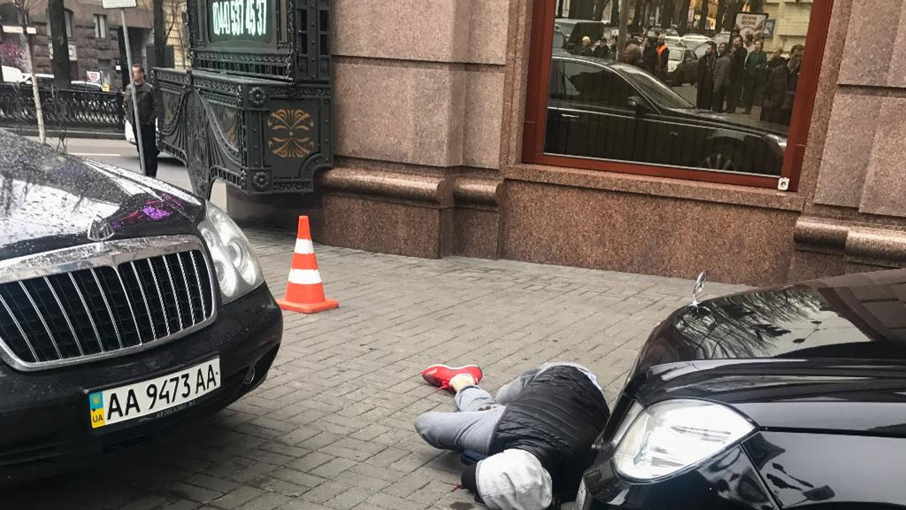 March 23: An assassin, who shot and killed Denis Voronenkov, lies wounded in Kiev, Ukraine.