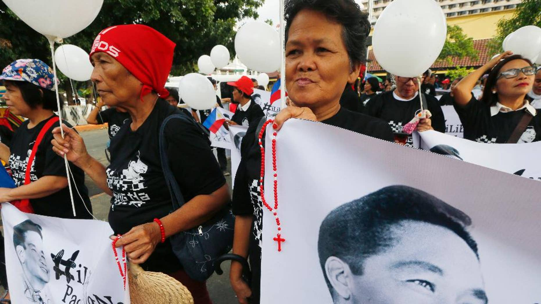 Supporters of the late dictator Ferdinand Marcos marching toward the Supreme Court for an overnight vigil.