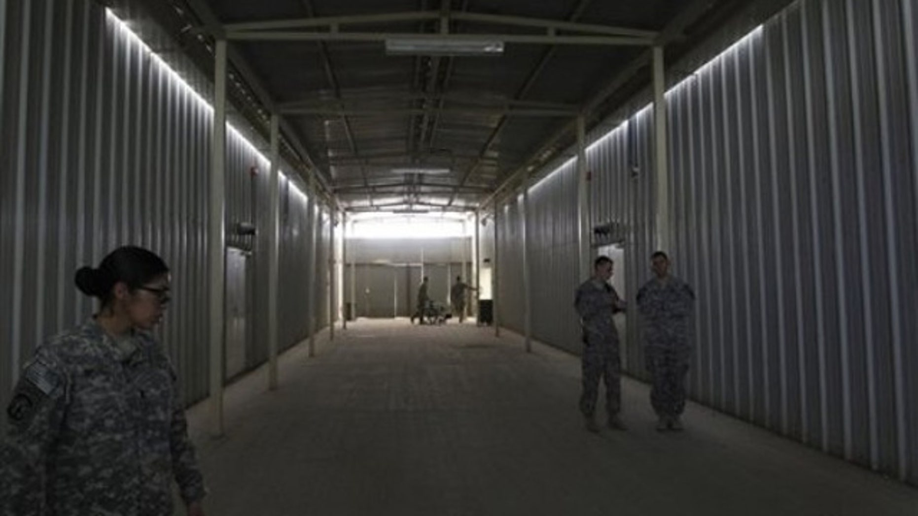 Aug. 27: U.S. soldiers stand outside cells at a newly built U.S.-run Parwan Detention Facility in Bagram north of Kabul, Afghanistan.