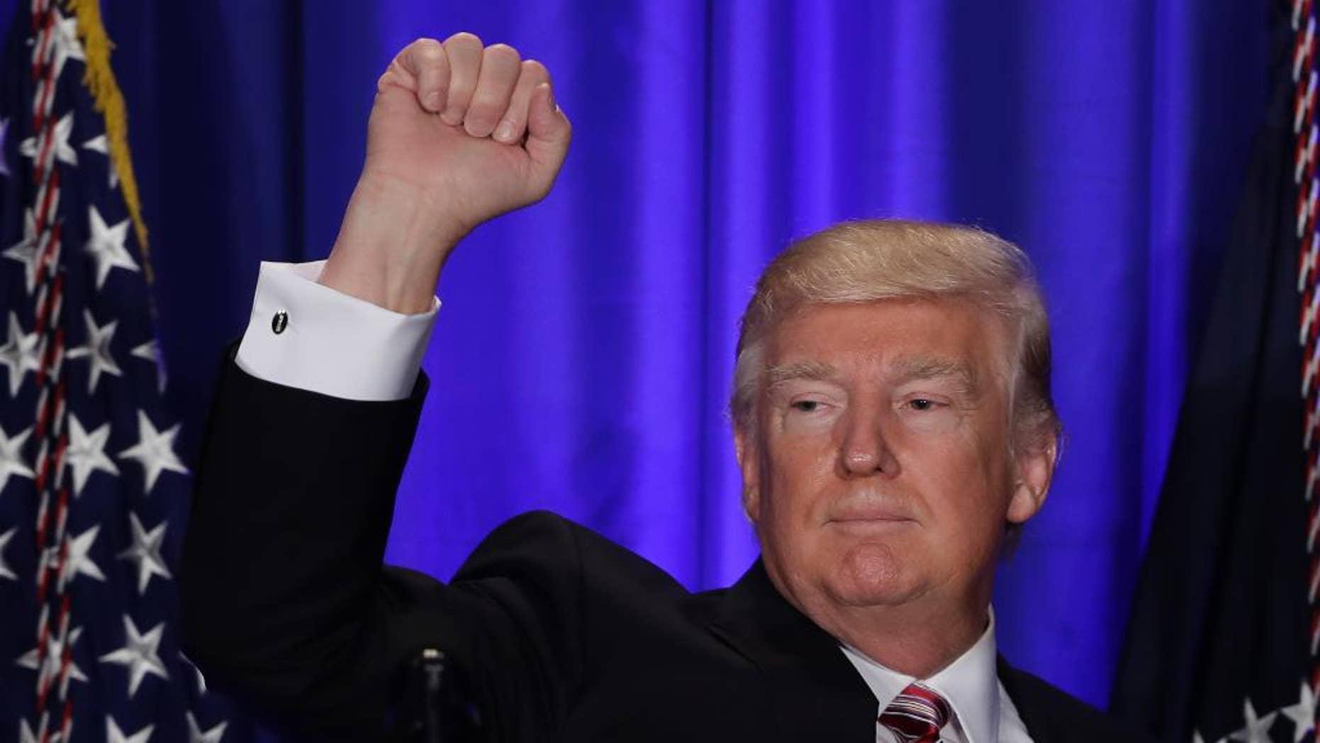 President Donald Trump gestures while speaking at the Republican congressional retreat in Philadelphia, Thursday, Jan. 26, 2017. (AP Photo/Matt Rourke)