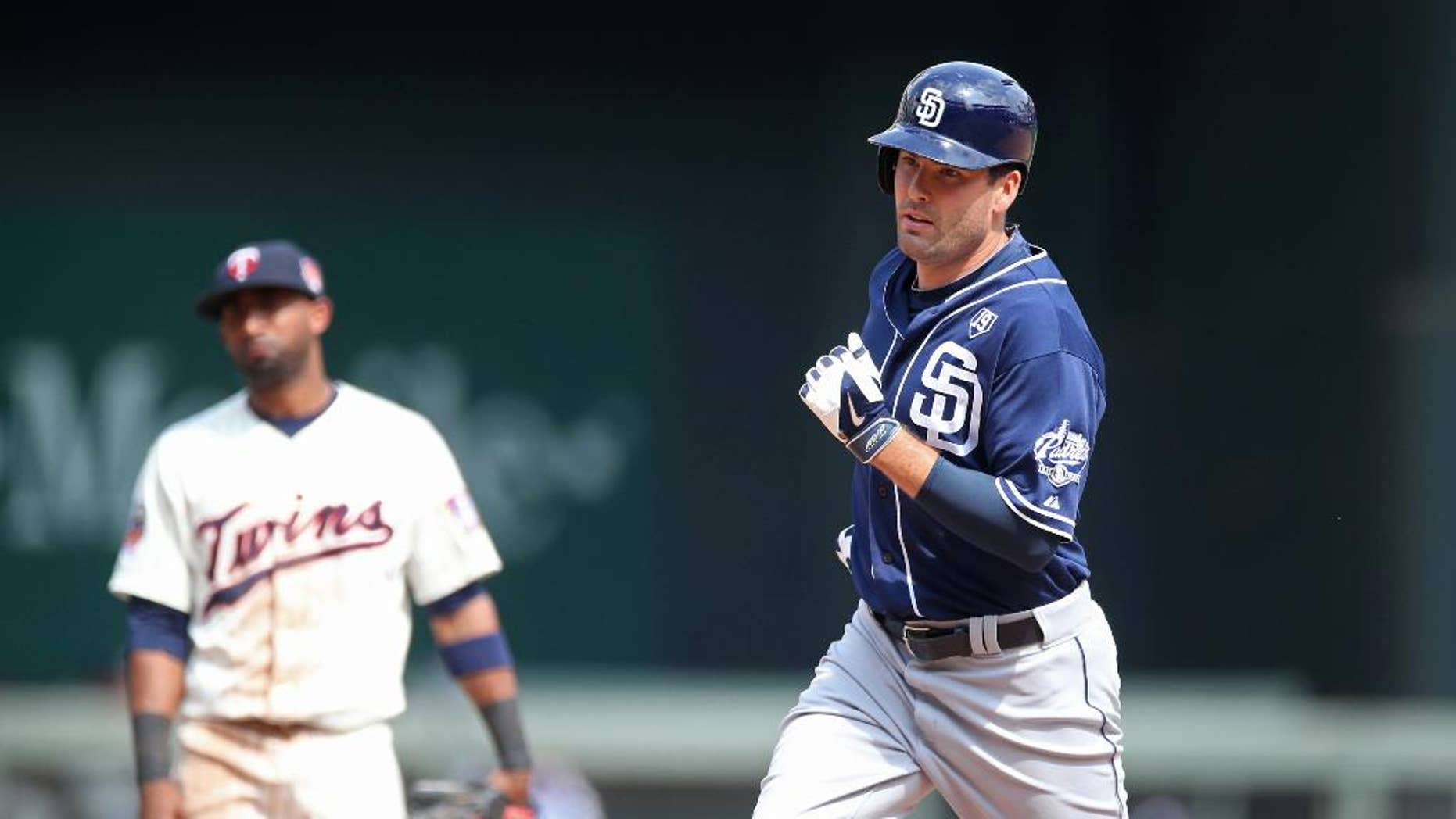 San Diego Padres' Seth Smith, right, rounds the bases on his decisive solo home run off Minnesota Twins relief pitcher Anthony Swarzak in the 10th inning of a baseball game, Wednesday, Aug. 6, 2014, in Minneapolis. The Padres won 5-4.  (AP Photo/Jim Mone)