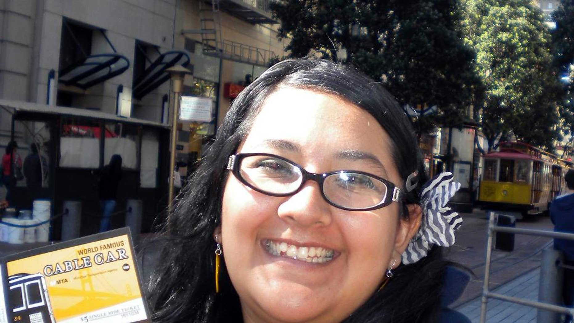 FILE - This undated file photo provided by Tatiana Ward shows Aurora Godoy during a trip to San Francisco. Godoy was killed during a Dec. 2, 2015, attack in San Bernardino, Calif. Los Angeles Harbor College says it will honor the memory of Godoy by awarding her a posthumous degree recognizing her as a member of its Class of 2016 during a board of trustees meeting Wednesday, May 11, 2016. (Tatiana Ward via AP, File)