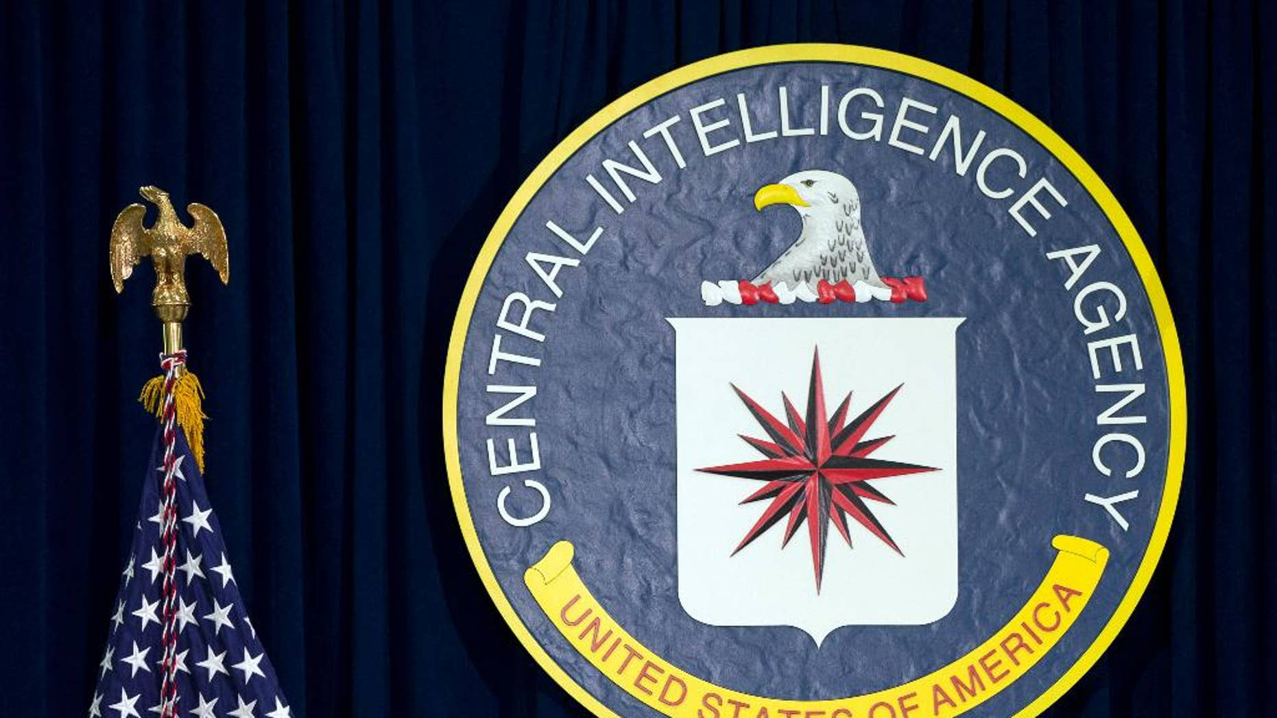 FILE - This April 13, 2016, file photo shows the seal of the Central Intelligence Agency at CIA headquarters in Langley, Va. WikiLeaks' release of nearly 8,000 documents that purportedly reveal secrets about the CIA's tools for breaking into computers, cellphones and even smart TVs has given rise to multiple theories about whodunit and why. (AP Photo/Carolyn Kaster, File)