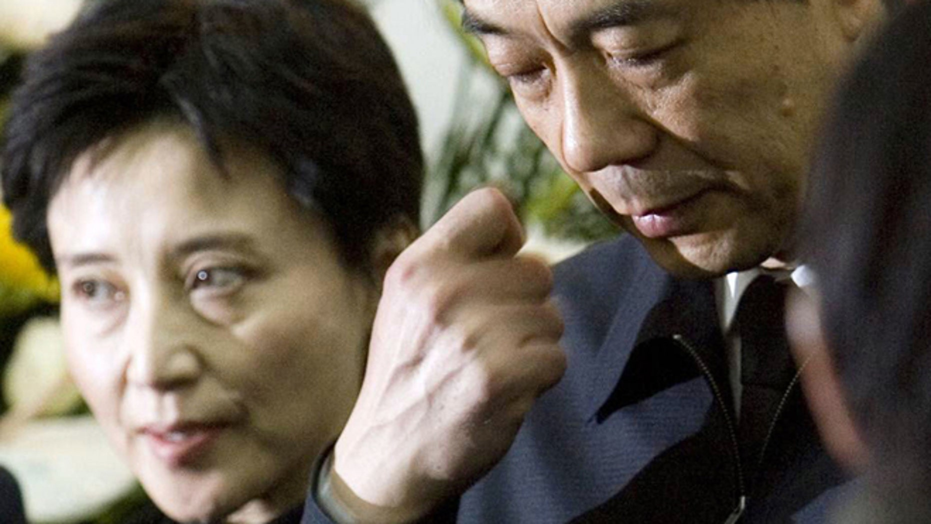 FILE - In this Jan. 17, 2007 file photo, former Chongqing Communist Party Secretary Bo Xilai, right, accompanied by his wife Gu Kailai, attends a funeral for his father in Beijing.