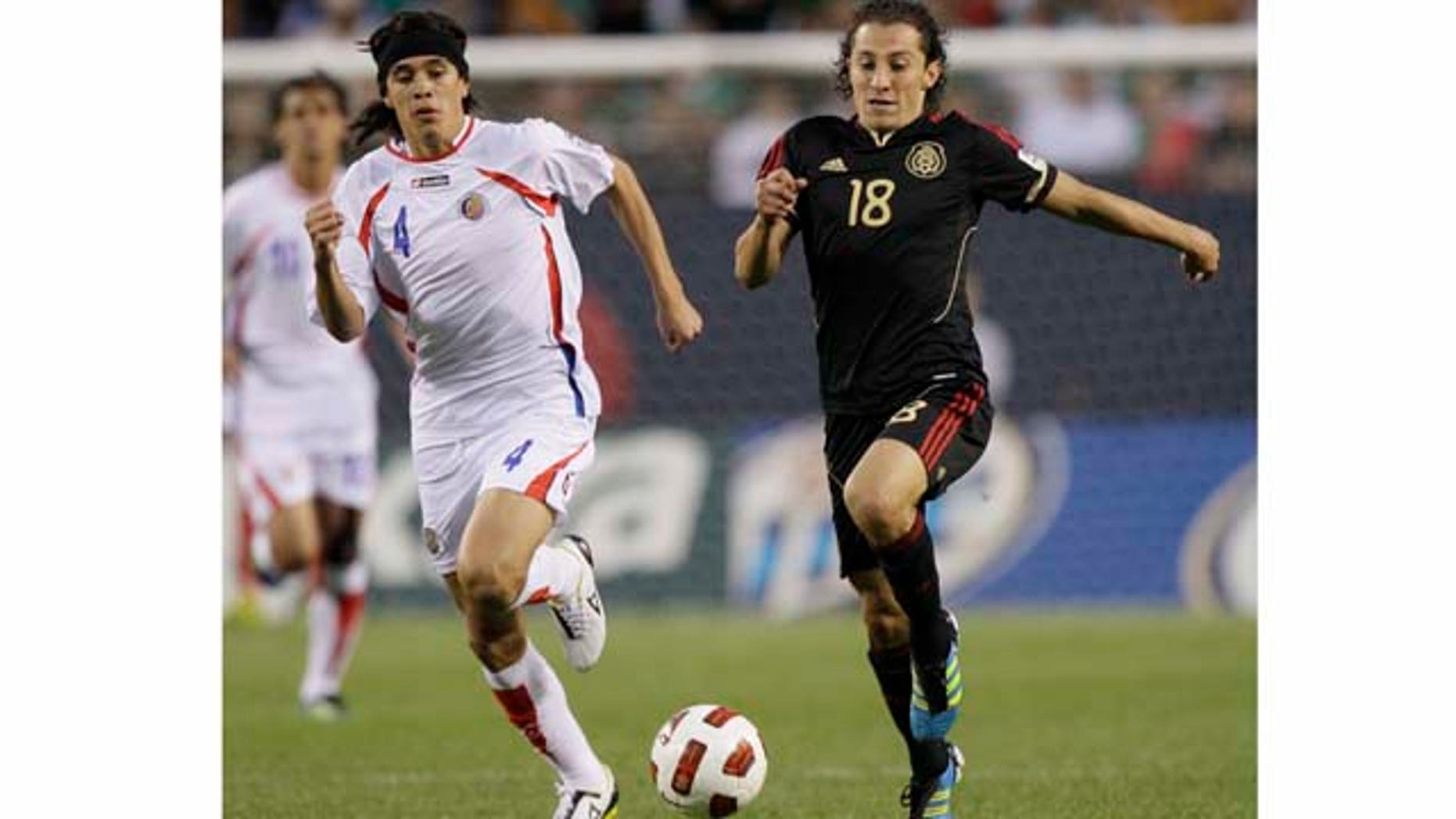 Mexico's Andres Guardado, right, controls the ball past Costa Rica's Jose Salvatierra during the second half of a CONCACAF Gold Cup soccer match at Soldier Field on Sunday, June 12, 2011, in Chicago. Mexico won 4-1. (AP Photo/Nam Y. Huh)