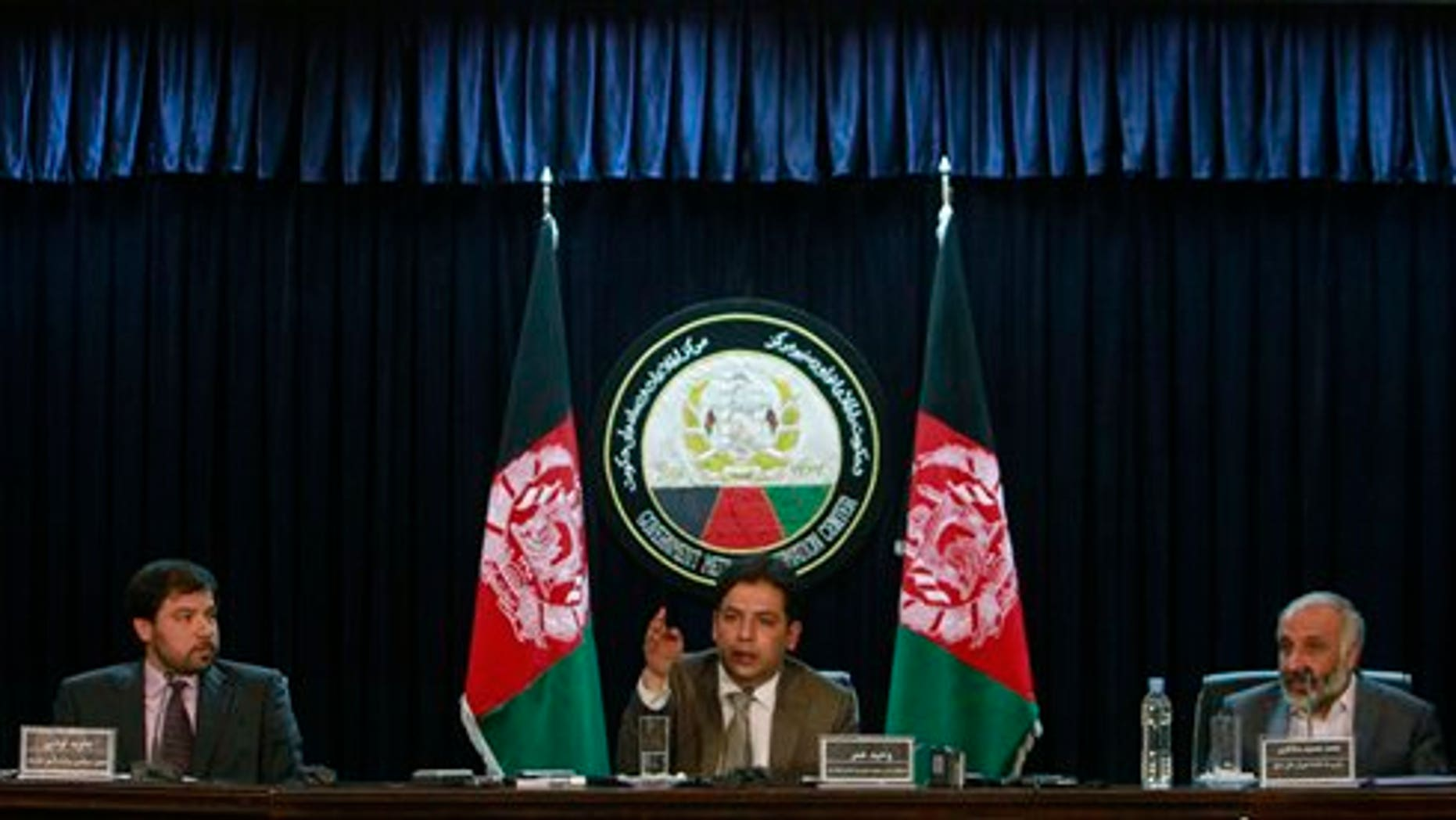 June 12: Afghan presidential spokesman Waheed Omar, center, speaks as Afghan Deputy Foreign Minister Jawid Luddin, left, and Masoom Stanekzai, right, secretary of a peace council set up by President Hamid Karzai listen during a press conference in Kabul, Afghanistan.