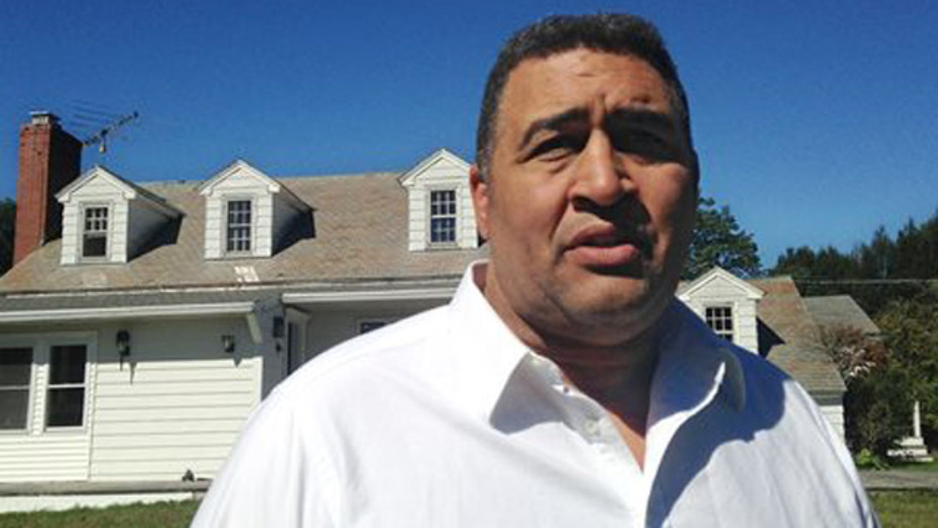 Sept. 18, 2013: Former NFL offensive lineman Brian Holloway stands in front of his rural vacation home.