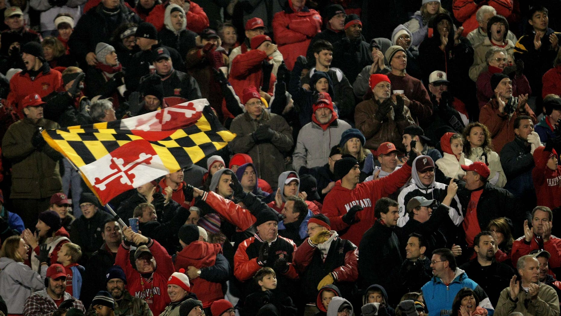 COLLEGE PARK, MD - NOVEMBER 10:  A Maryland fan waves the state flag as the Boston College Eagles square off against the Maryland Terrapins at Byrd Stadium on November 10, 2007 in College Park, Maryland.  (Photo by Doug Pensinger/Getty Images)