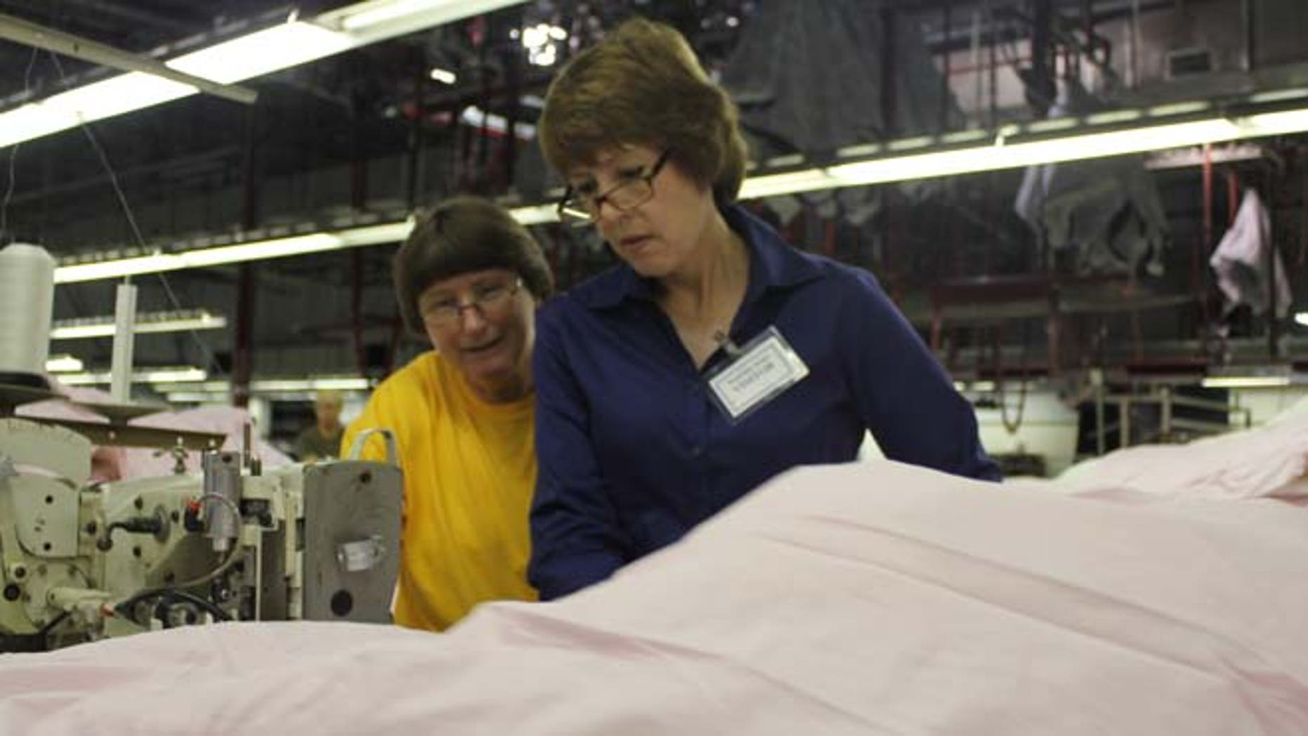 "Rep. Gwen Graham, D-Fla., works on the factory floor during a ""workday."""
